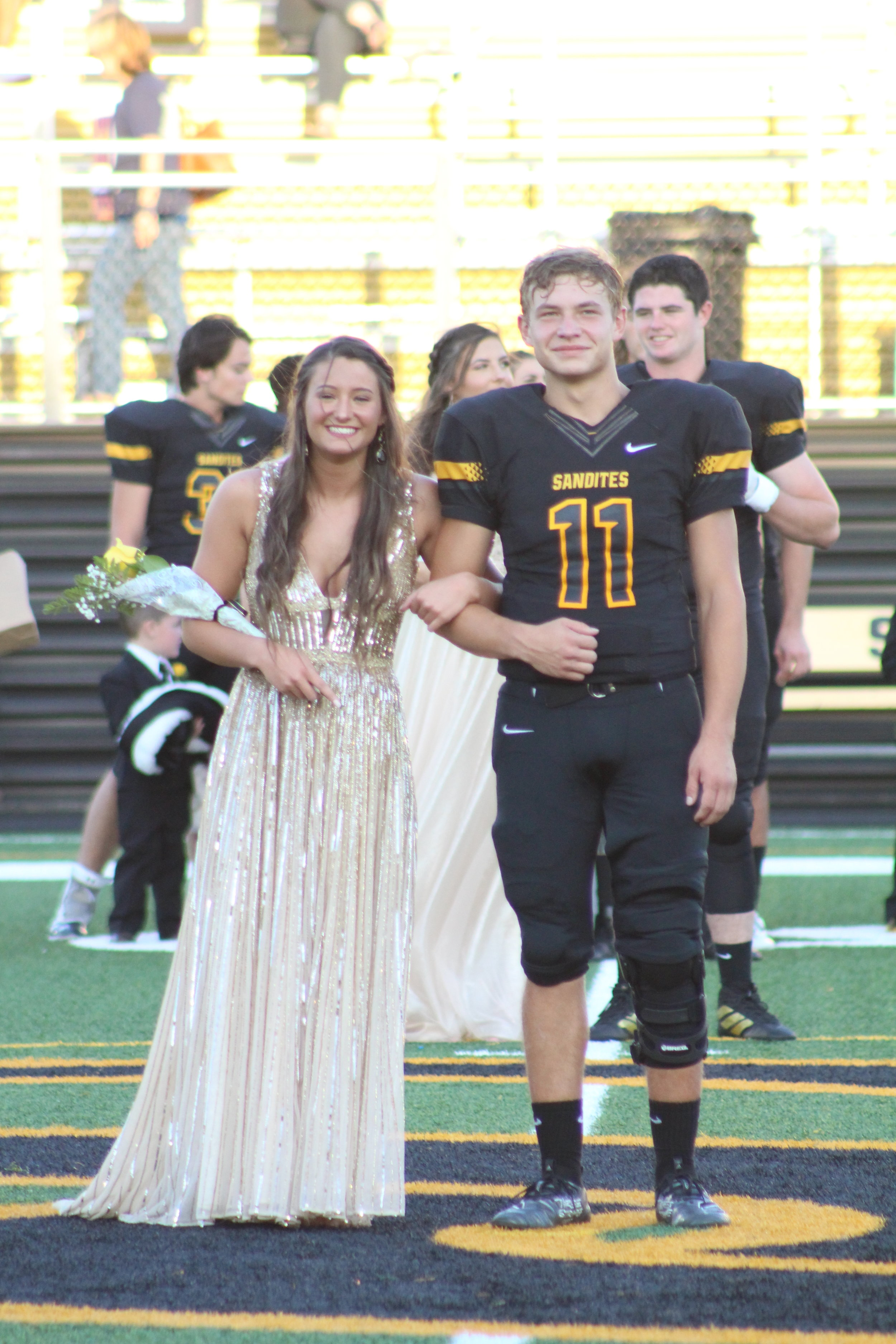 Raegan Foster, escorted by Braden Foster. Raegan is the daughter of Alan and Lisa Foster, and has been on the varsity Dance Team for two years. Braden is the son of Evan and Amanda Foster and is a three-year varsity quarterback and wide receiver.
