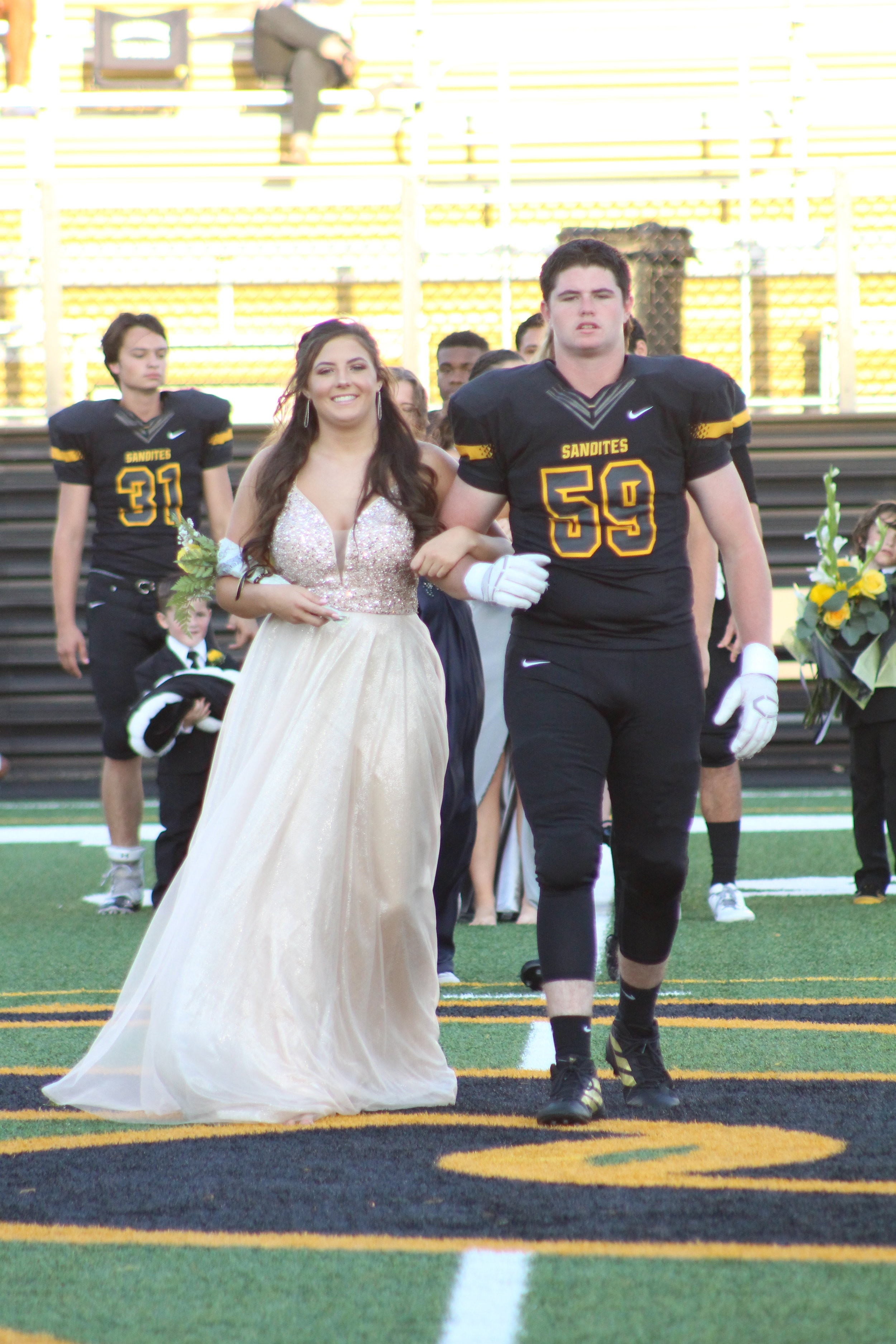 Taylor Spencer, escorted by Josh Fincannon. Spencer is the daughter of Brett Spencer and Terra Jordan Rhoads. She is a four-year varsity cheerleader. Fincannon is the son of Jason and Kristy Fincannon and is a three-year varsity offensive lineman.