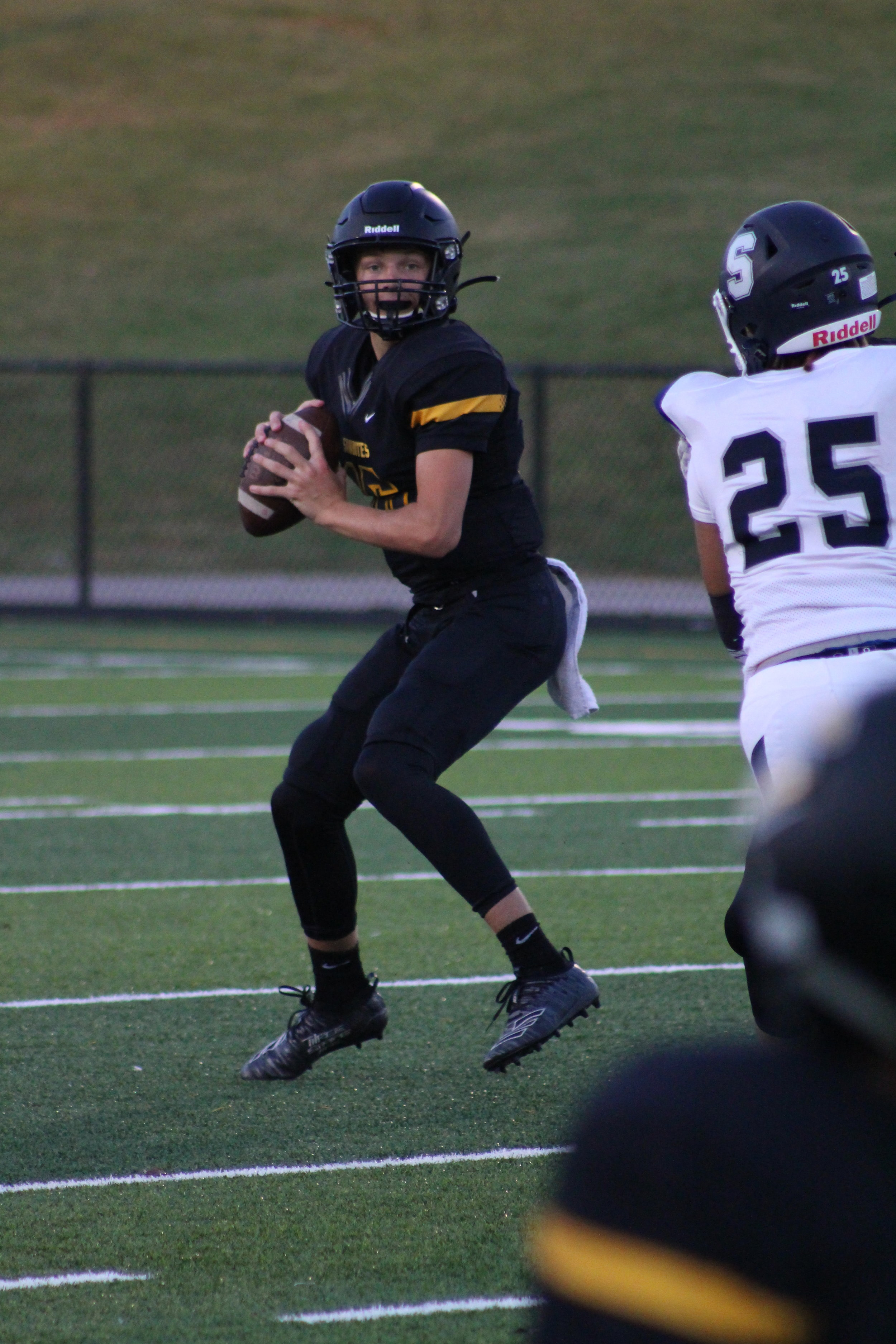 """6'2"""" sophomore Ty Pennington looks for an open receiver while under pressure from Justin Simpson. Pennington finished the night 13-27-143-0 with one touchdown against Shawnee. He has 7 touchdowns and 0 interceptions this season."""