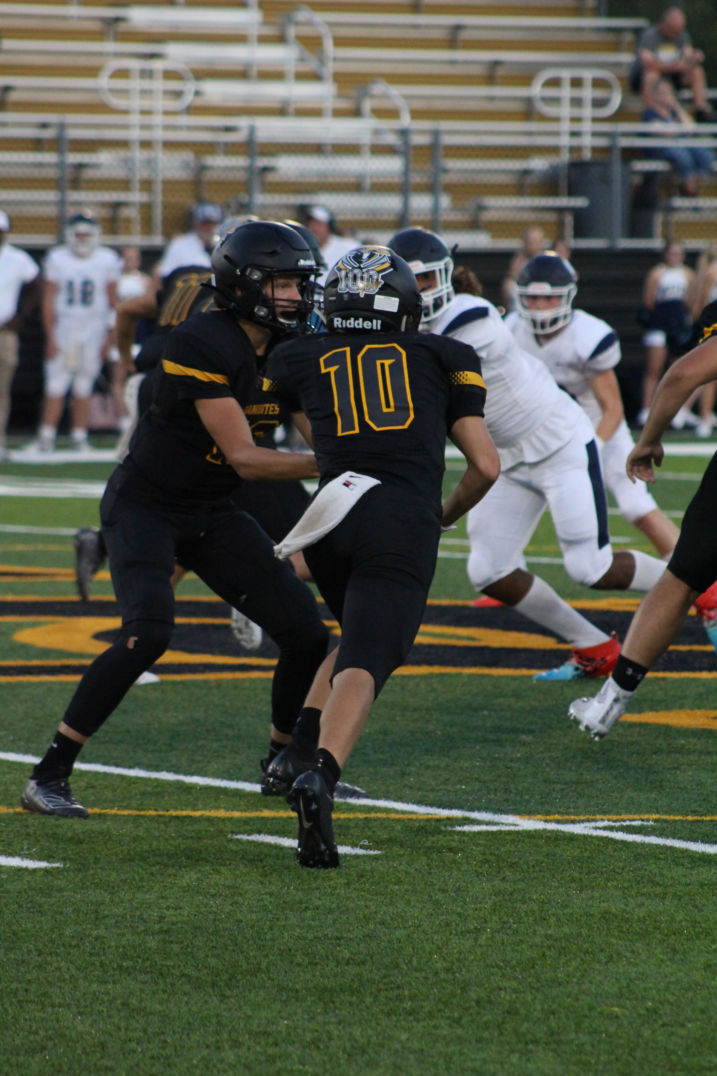 """Ty Pennington hands the ball off to 5'10"""" sophomore Blake Jones. Jones was 1-22 receiving and 21-86 rushing against the Wolves."""