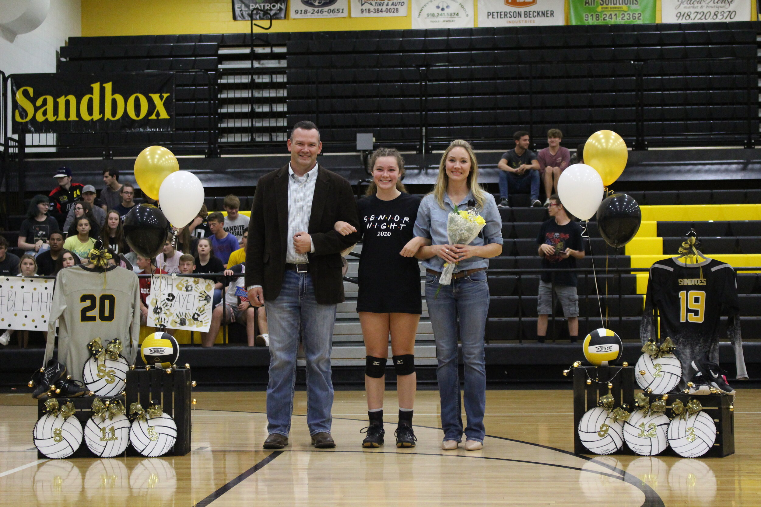 """Makenzie Harris (RSH) escorted by parents Brad and Sarah Harris. She is a 6-year Sandite Volleyball player who also plays basketball. She plans on attending the University of Arkansas.  """"Thank you to my teammates and my 6 girls who have stuck with me through every season's ups and downs. Thank you to my family for always supporting me throughout every season's highs and lows. I love you all so much.""""  Harris left the following words for her underclass teammates. """"Don't let anything get between you guys, you really do become like sisters throughout your years together. You guys are going to bicker and argue, but just brush it off and stick together!"""""""
