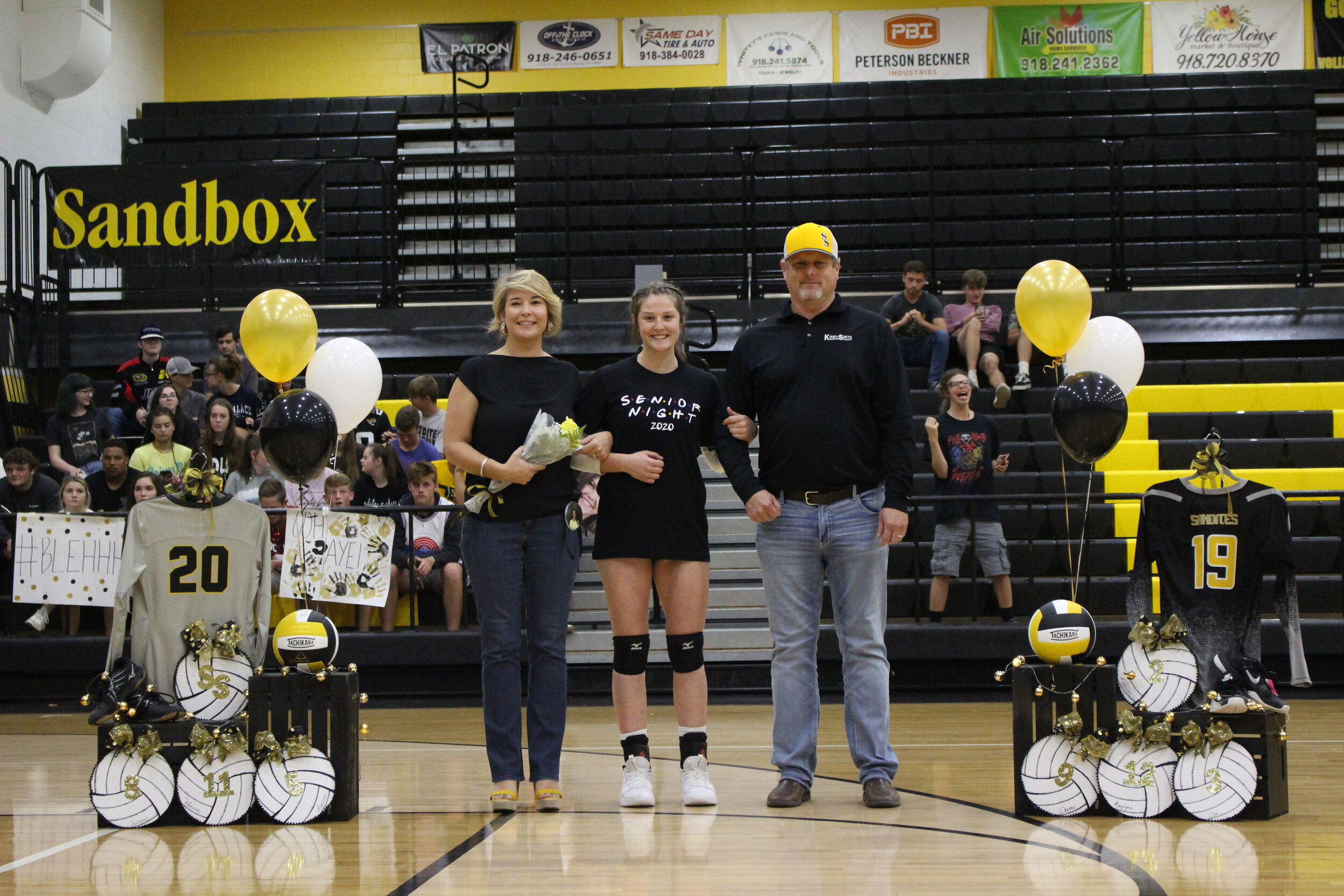 """Madison Burris (S, RSH), escorted by parents Brian and Jamie Burris. She has played Sandite Volleyball for 6 years, plays on the Girl's Basketball Team, and is a member of National Honor Society. She is undecided on a college, but plans on majoring in Interior Design and Business.  Burris's favorite volleyball memory was Senior Night two years ago when the Sandites swept Ponca City 3-0. """"It was the best game ever,"""" says Burris.  """"Thank you to my whole family and friends for all the support they've always give men. Also, thank you to my coaches and past coaches throughout the years."""""""