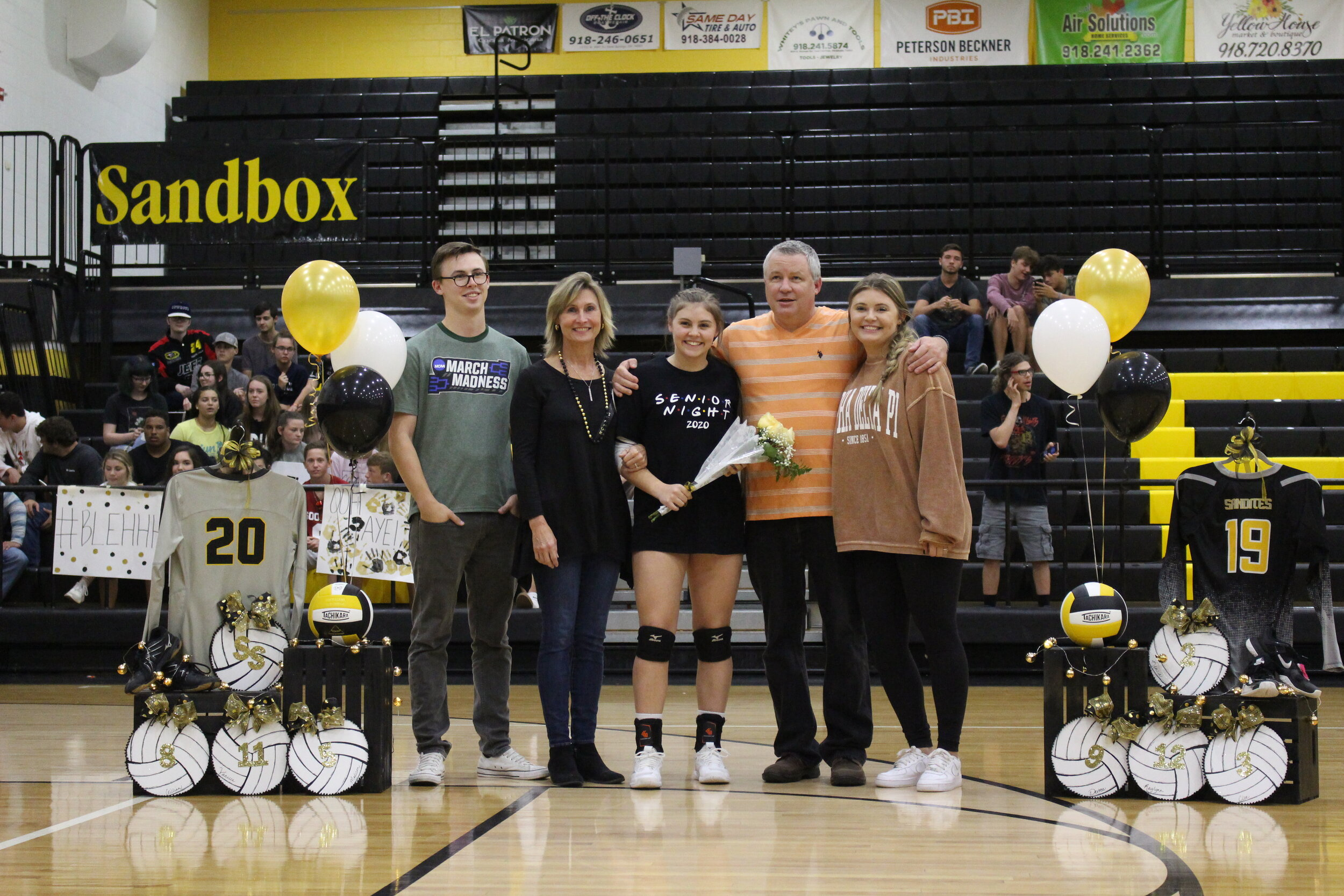 """Cloe Campfield (OSH, DS) escorted by parents Tripp and Andrea Campfield, and siblings Troy and Dayne Campfield. She has played Sandite Volleyball for 6 years, is a National Honor Society and Student Council member, and a manager for the Boys' Basketball Team. She plans on attending Oklahoma State University to major in history, with the goal of being a High School History Teacher.  Campfield's favorite volleyball memory is beating Union her junior year.  """"Thank you to my fellow seniors for being there through every up and down."""""""