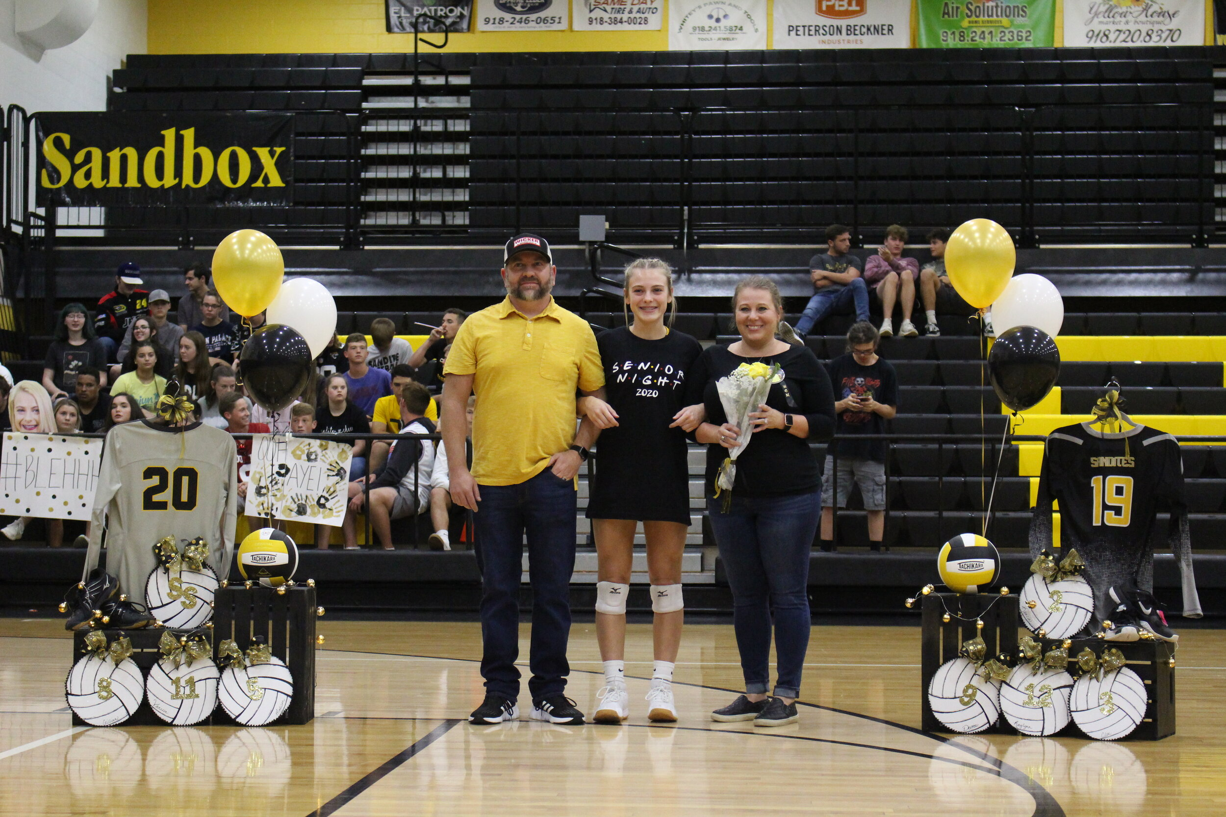 """Gillian Wicker (DS), escorted by parents Steve and Stacy Wicker. She has played Sandite Volleyball for 6 years and plans to continue her education at Oklahoma State University, where she will major in Communications Sciences and Disorders.  Wicker's favorite volleyball memory was when she and Coach Green came up with """"Nicole"""" in Branson her freshman year. She left the following message for her teammates. """"Always be yourself and work hard."""""""