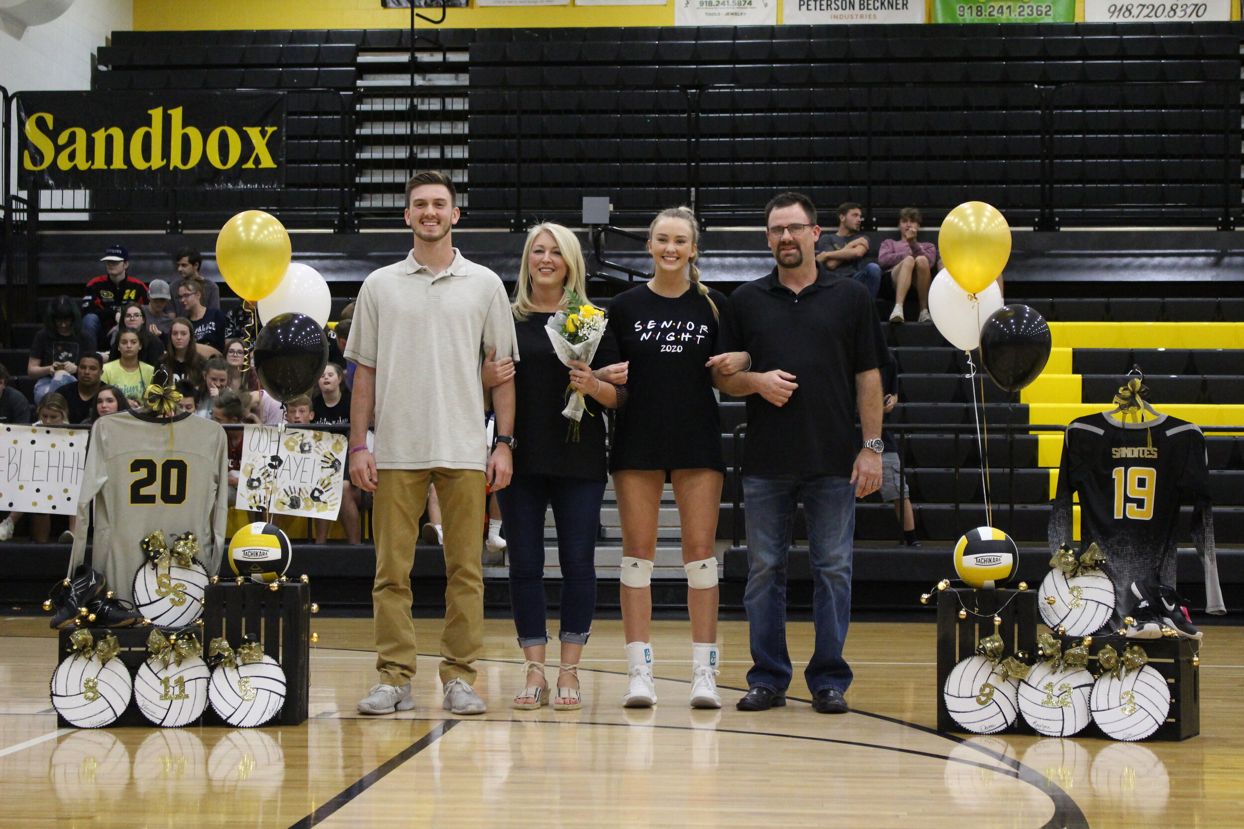 """Devree Youngblood (OSH), escorted by parents Jeff and Dawn Youngblood, and brother Brock Youngblood. She has played Sandite Volleyball for 6 years and will continue her career on a scholarship at Oklahoma Baptist University, where she will major in Marketing. She is involved in National Honor Society and Special Olympics.  Youngblood's favorite volleyball memory is """"when we swept Union at home my freshman year.""""  """"Thank you to my parents for supporting me and giving me the opportunity to play volleyball. I want to thank my Sand Springs coaching staff, Janna Green, Darrell Pearson, ad B-MAG for everything you've taught me. And to my team, high school has been a privilege to play along side of each of you."""""""