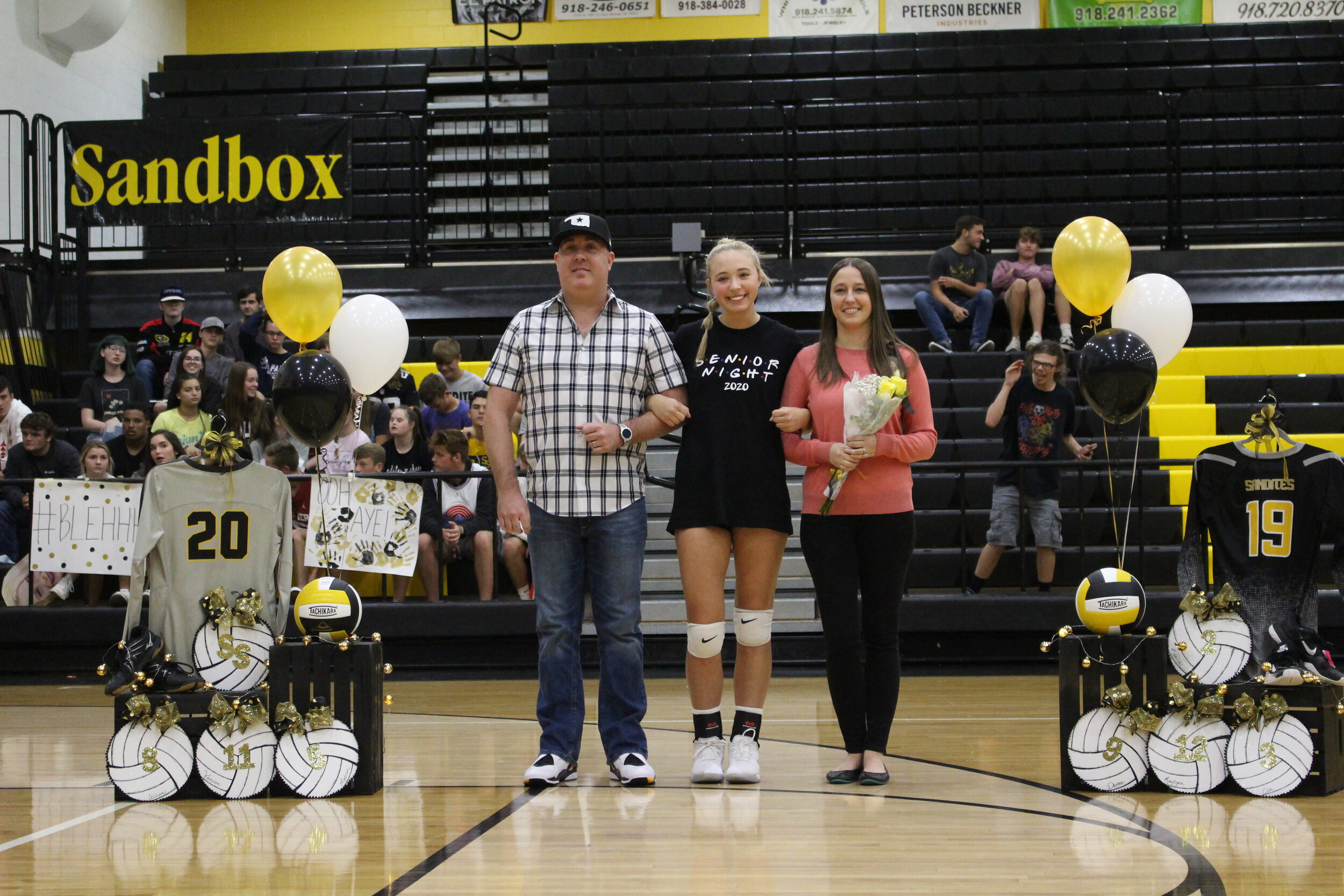 """Vanessa Wyrick (MB), escorted by parents Ashley Elliott and Mike Helt. She was played Sandite Volleyball for 6 years and is a member of National Honor Society. She is undecided on a college, but plans to major in Dental Hygiene.   Wyricks favorite volleyball memory is """"going to the fair freshman year as a team after the Bishop Kelley Tournament."""""""