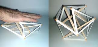 Tensegrity model being distorted and springing back to life.