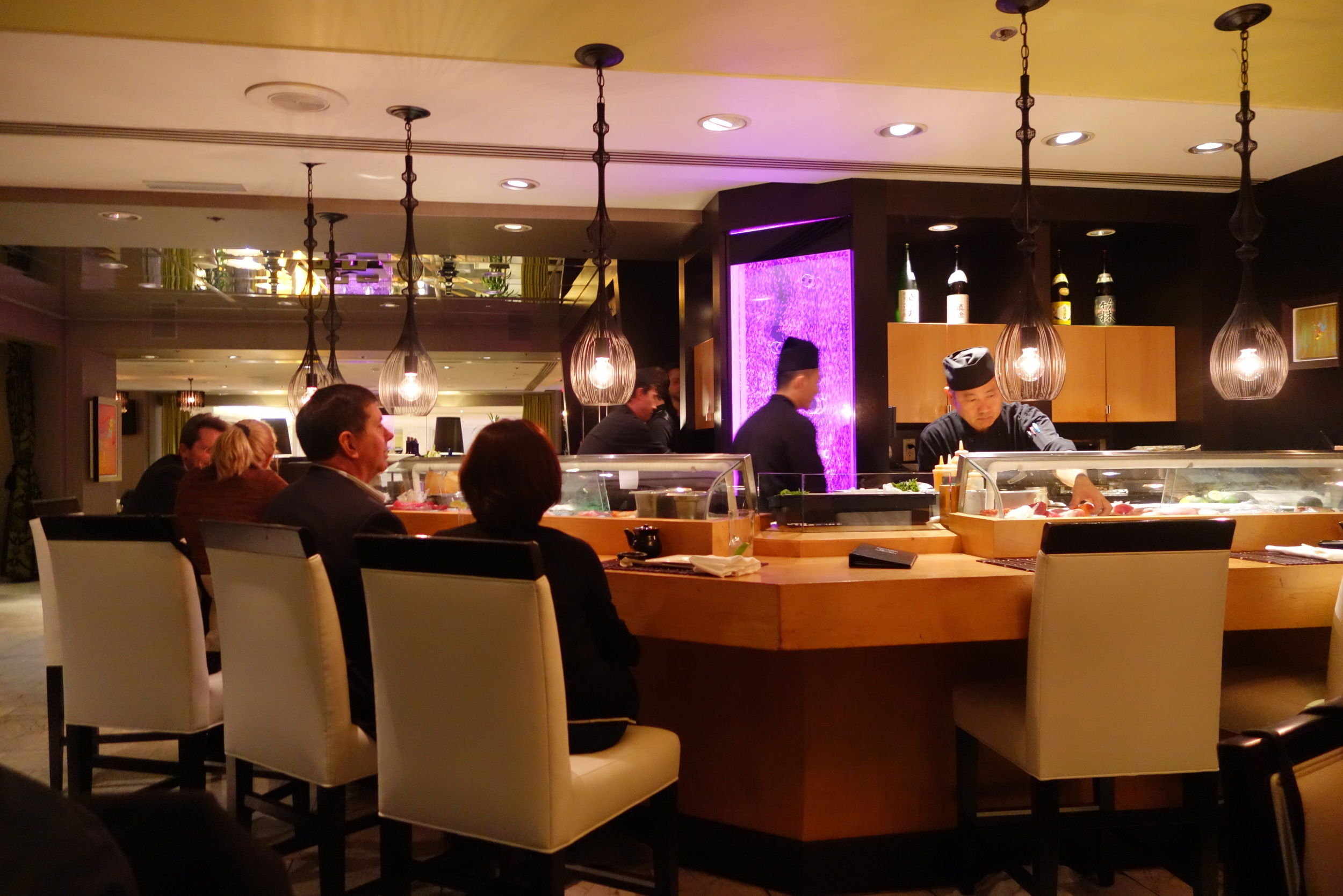 Customers at the Sushi Bar in Anzu Restaurant and Bar.