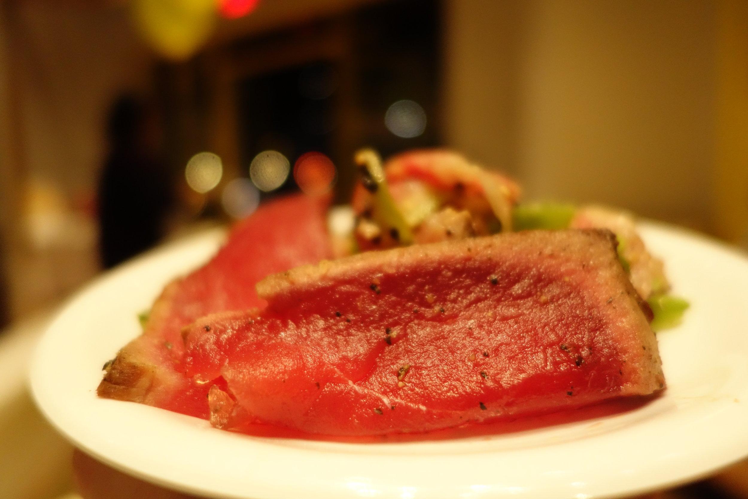 Seared Ahi Tuna with crushed orange-ginger ponzu.