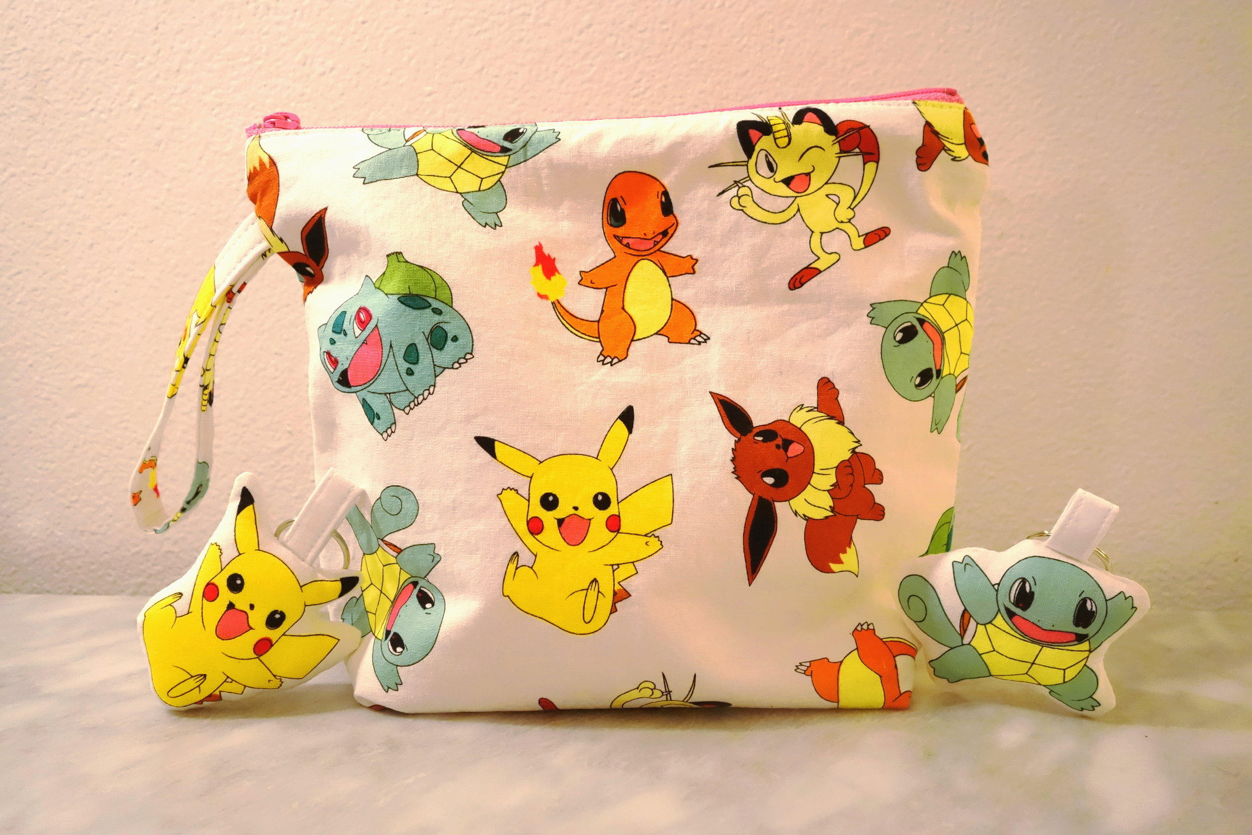 Pokemon Bag (Center), Pikachu Pillow Keychain (Left) & Squirtle Pillow Keychain (Right)