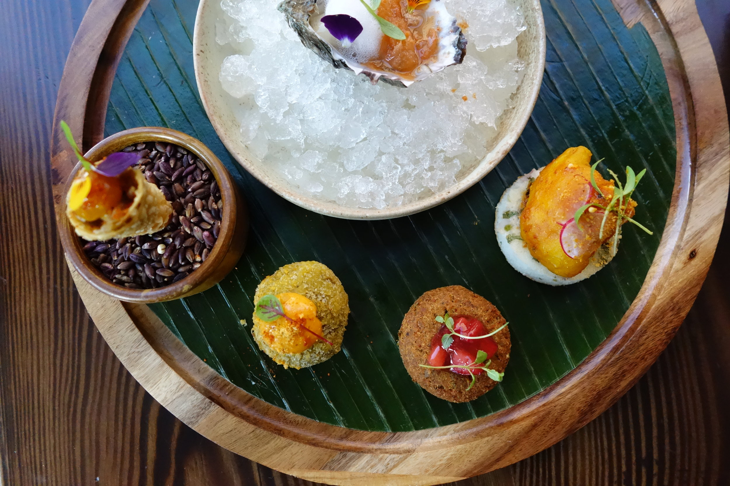 Appetizers by Rooh SF's Executive Chef Sanjay Sarkar.  Madras Duck Cornetto with Apricot Jam, Cauliflower 65 with Mini Onion Uttapam, Oyster with Hansen's Key Lime Twist and Guava Granita, Chicken Shami Kebab with Plum Chutney, Pulled Beef Madras Croquettes.