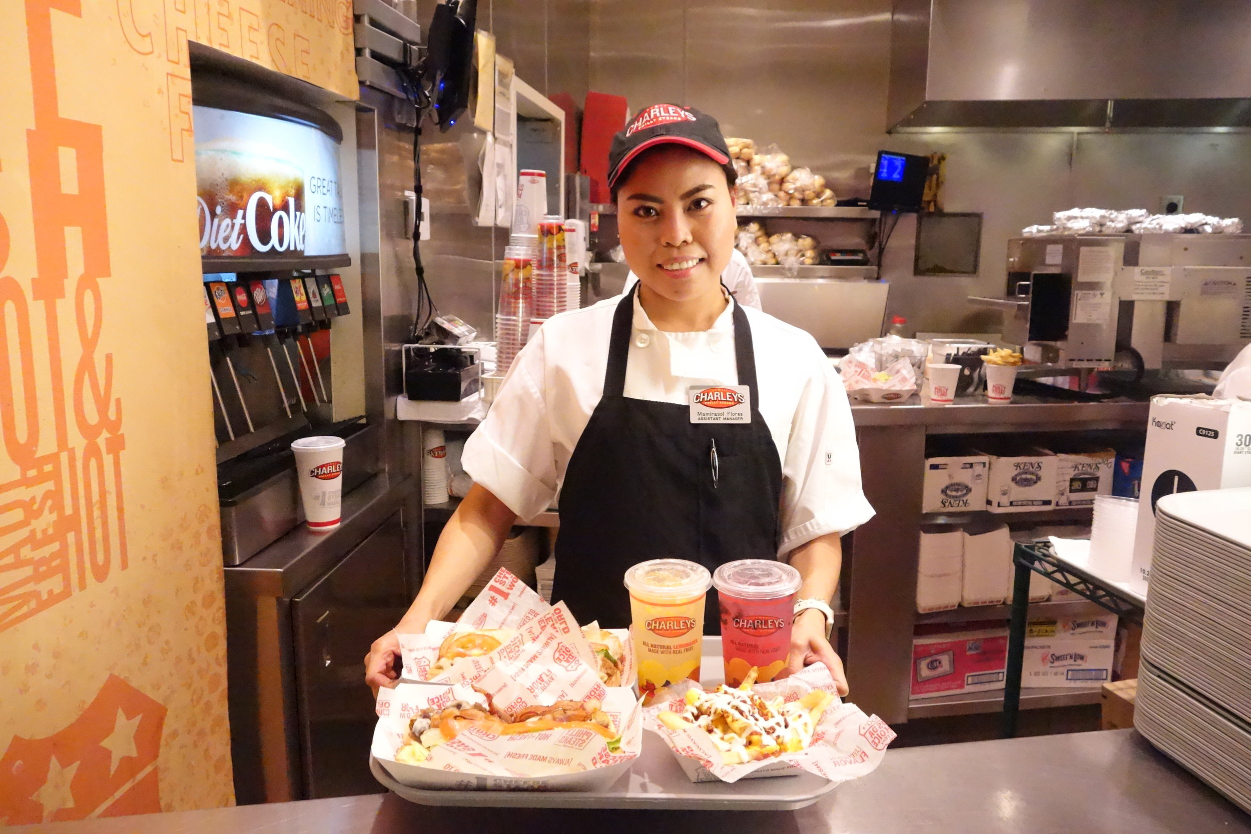 Assistant Manager, Mamirasol Flores brings us our order at the Westfield San Francisco Centre.