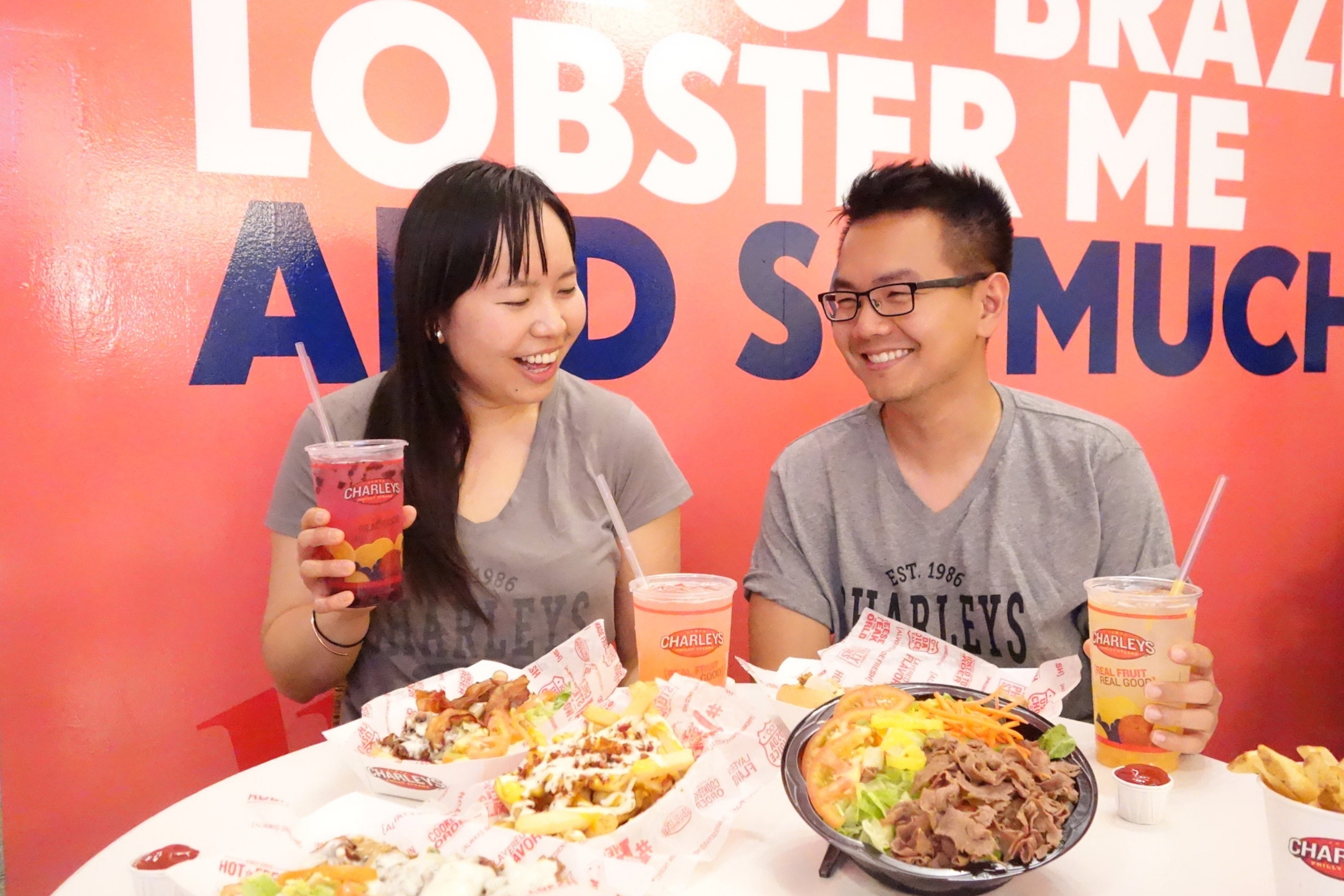 Sandy L. & her good friend Nhan N. share a laugh as they eat at Charley's in Downtown SF.