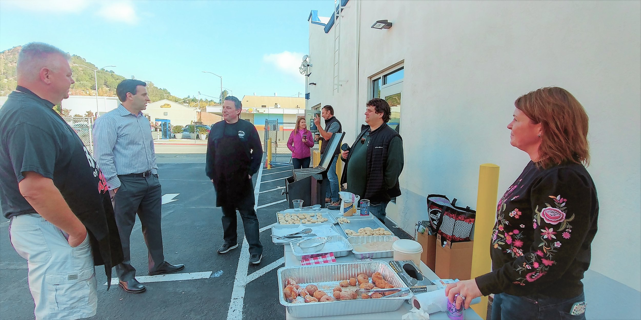 "Jason Ford  (2nd from the left), with his team of volunteers for the ""Donuts for Donations"" Campaign"