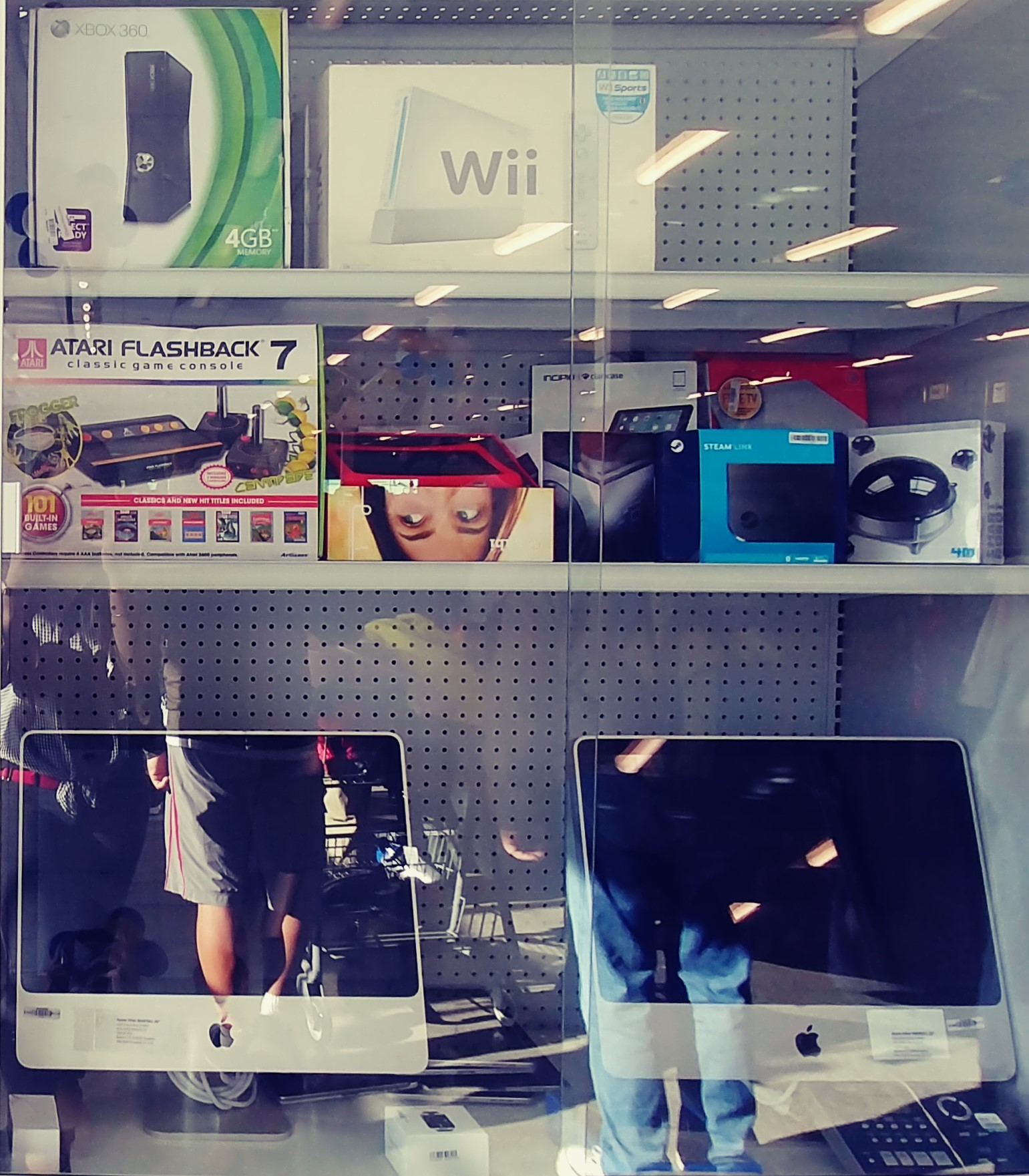 A display case of brand-name electronics at Goodwill San Rafael