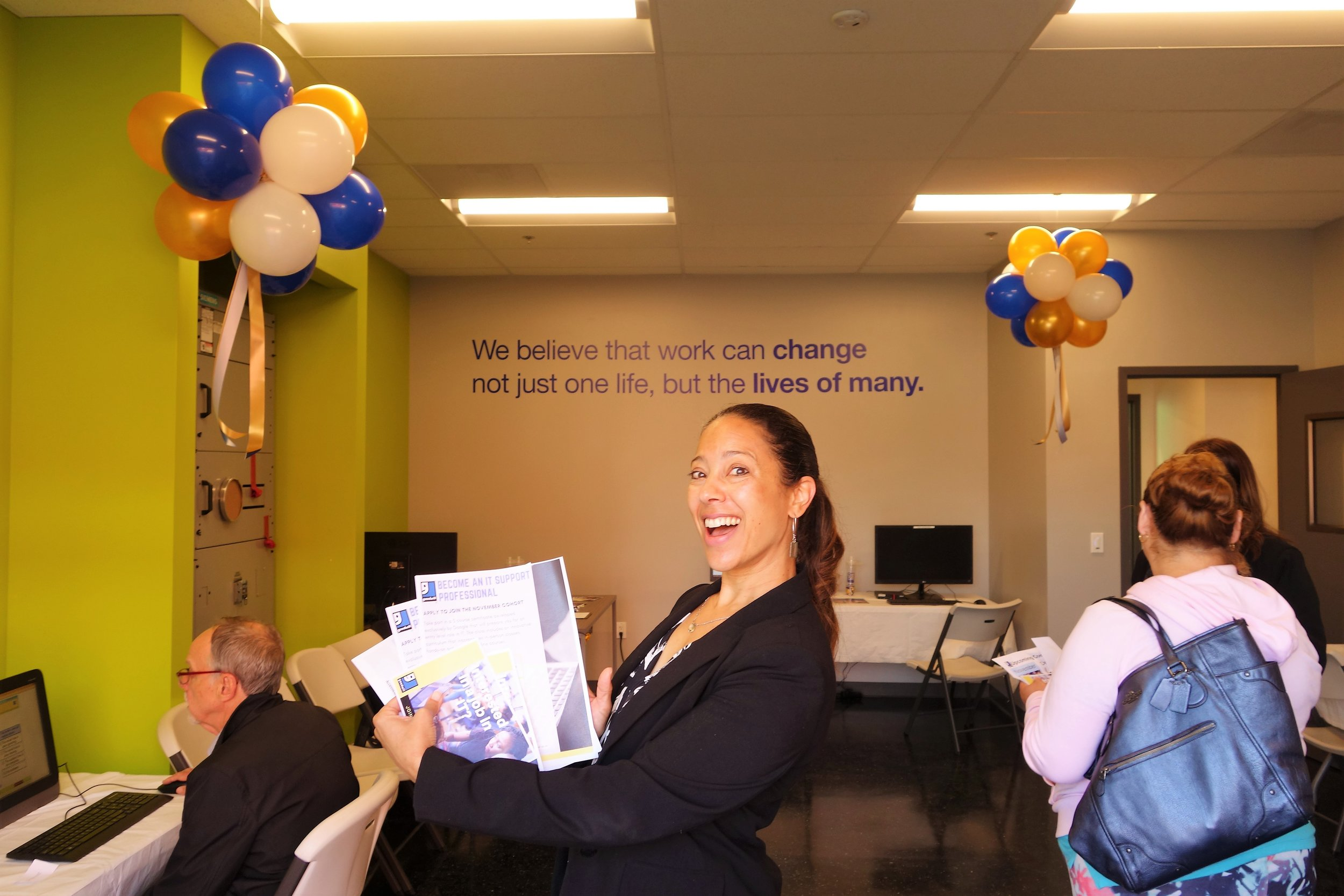 Tanya Moore , Goodwill VP of Mission Advancement, showcases Goodwill pamphlets that are given out to interested job seekers searching for career training and Goodwill services