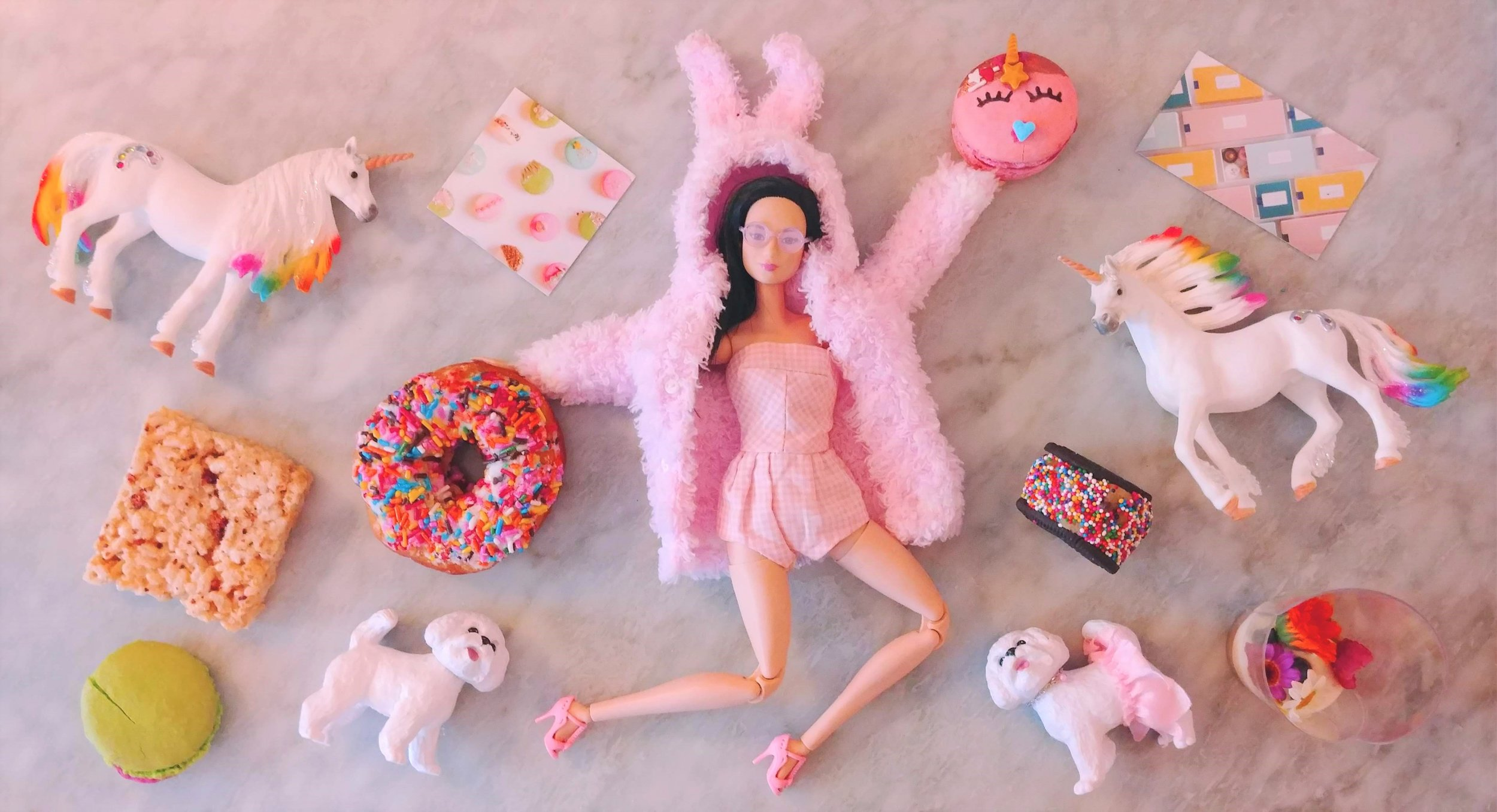 Foodie Barbie posing with various desserts from the Sweet Spot Fest dessert festival