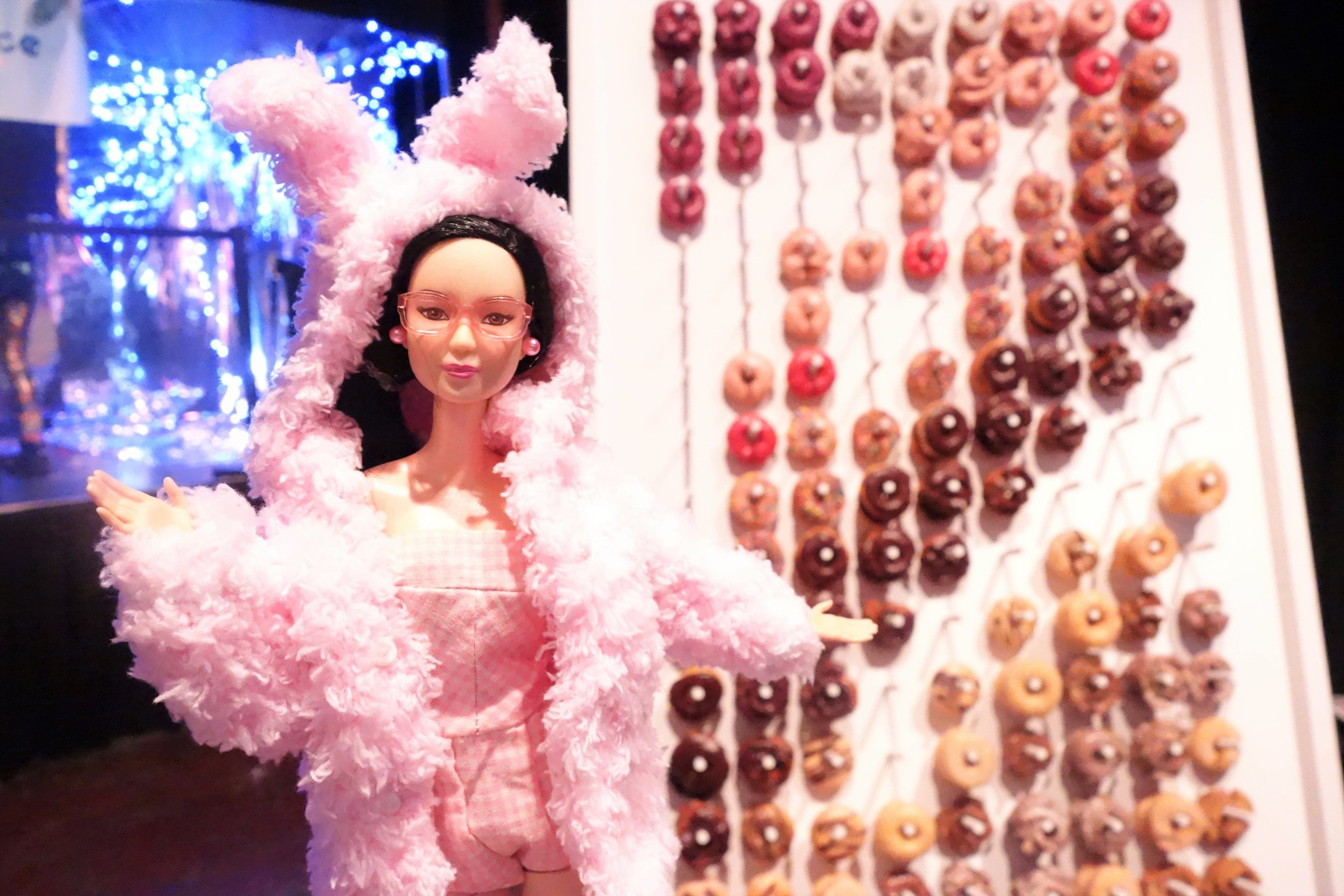 Foodie Barbie in front of the 10-foot doughnut wall by Johnny Doughnuts