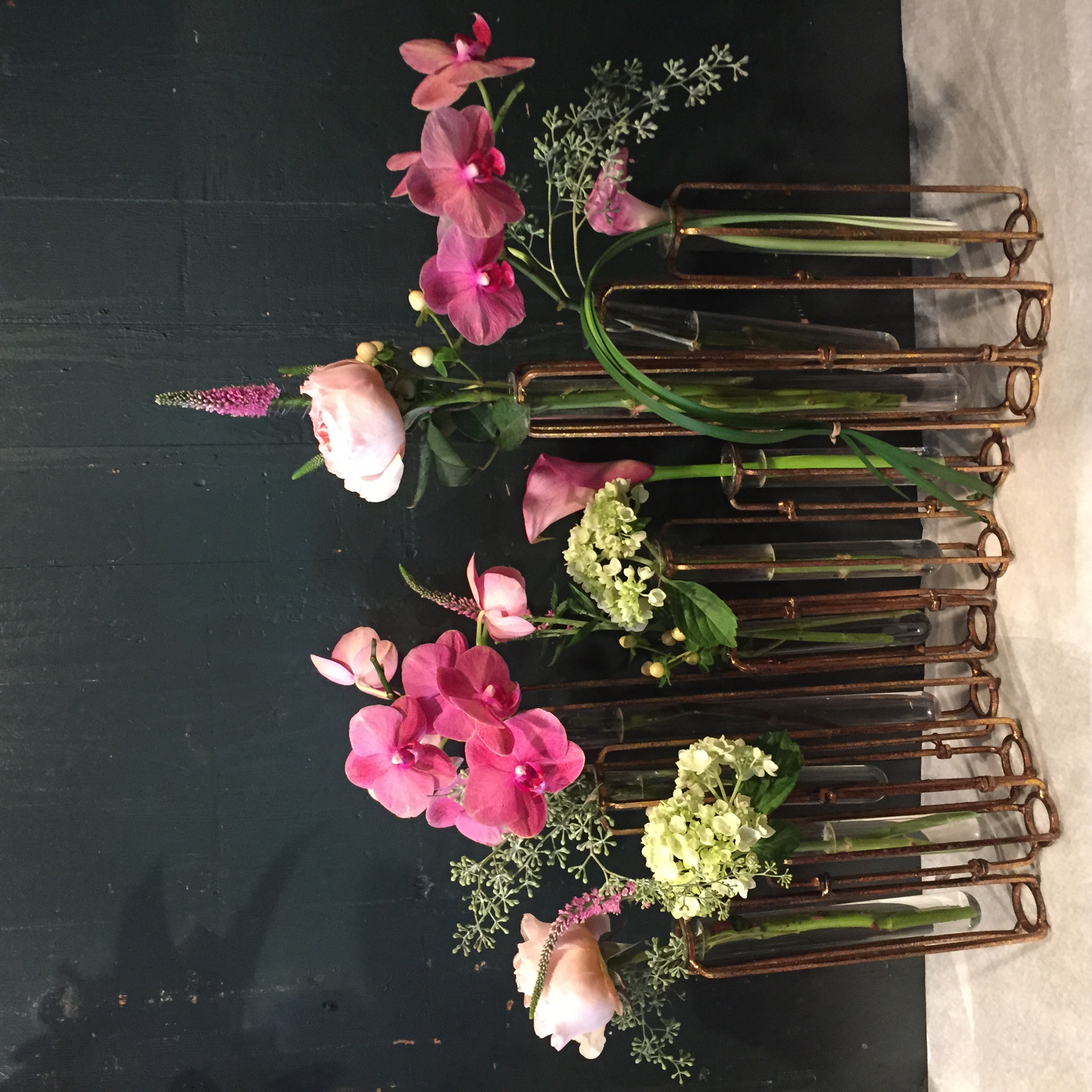 """We find that using traditional """"gardeny"""" cut flowers such as garden roses and veronica providea lovely softcontrast to the smartmetal anglesof theframe."""