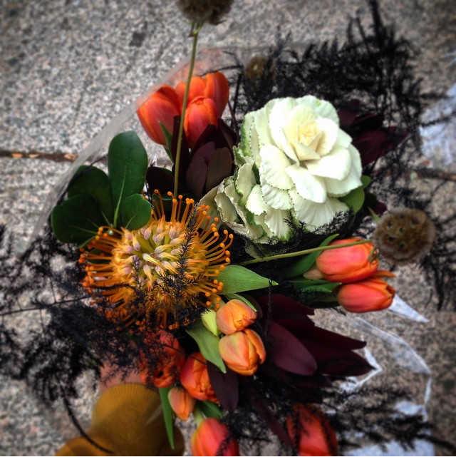 This eerie hand-tied bouquet features fall classics like white kale, scabiosa pods and black feather fern.