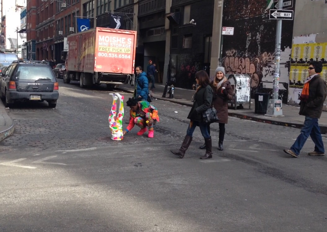 """This guy was just singing and dancing and painting his """"legs"""" in the middle of the street in NYC. Artists... *SMH..."""