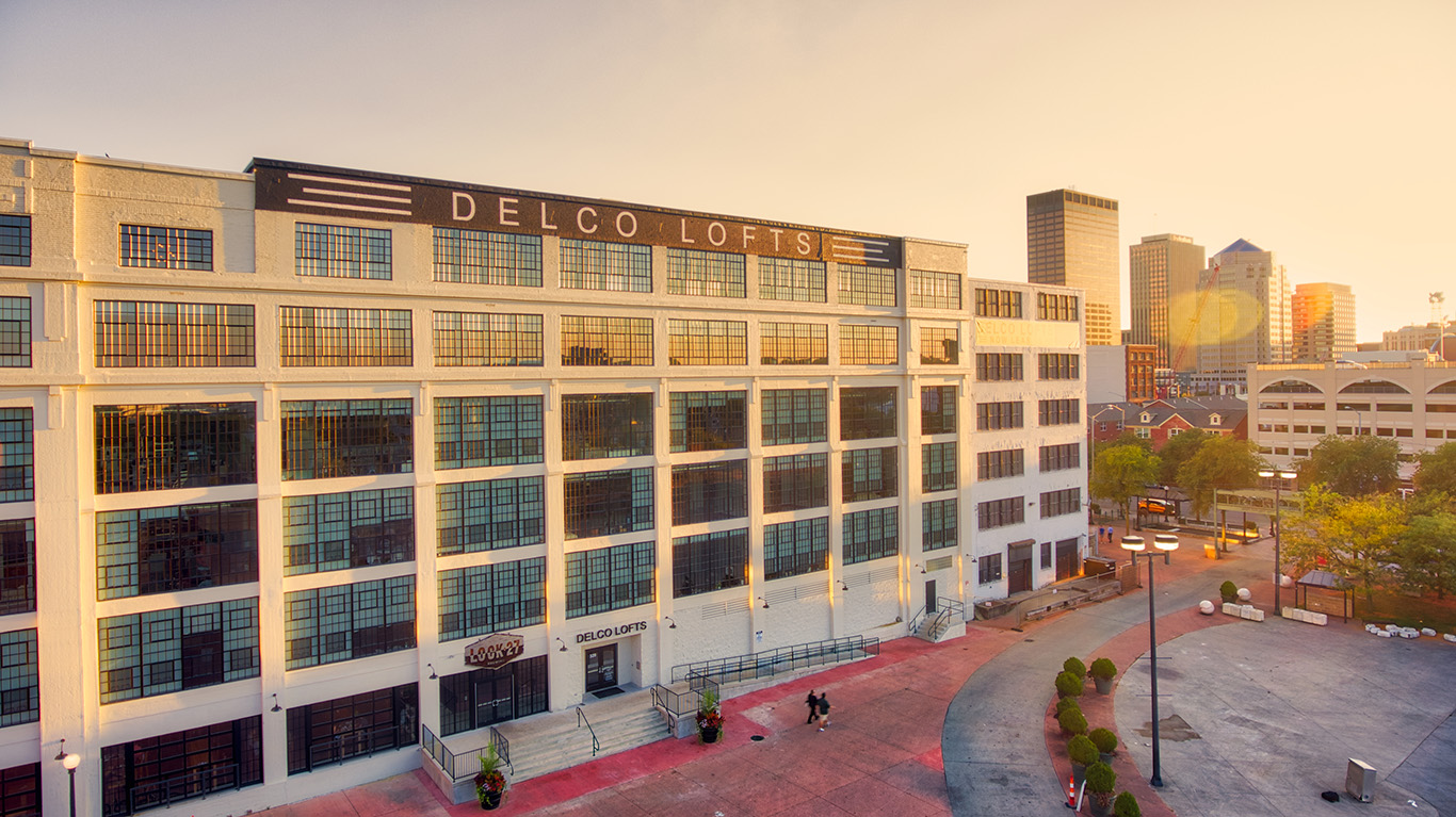 """Apartment building at sunset in Dayton Ohio with sign that reads """"Delco Lofts"""""""