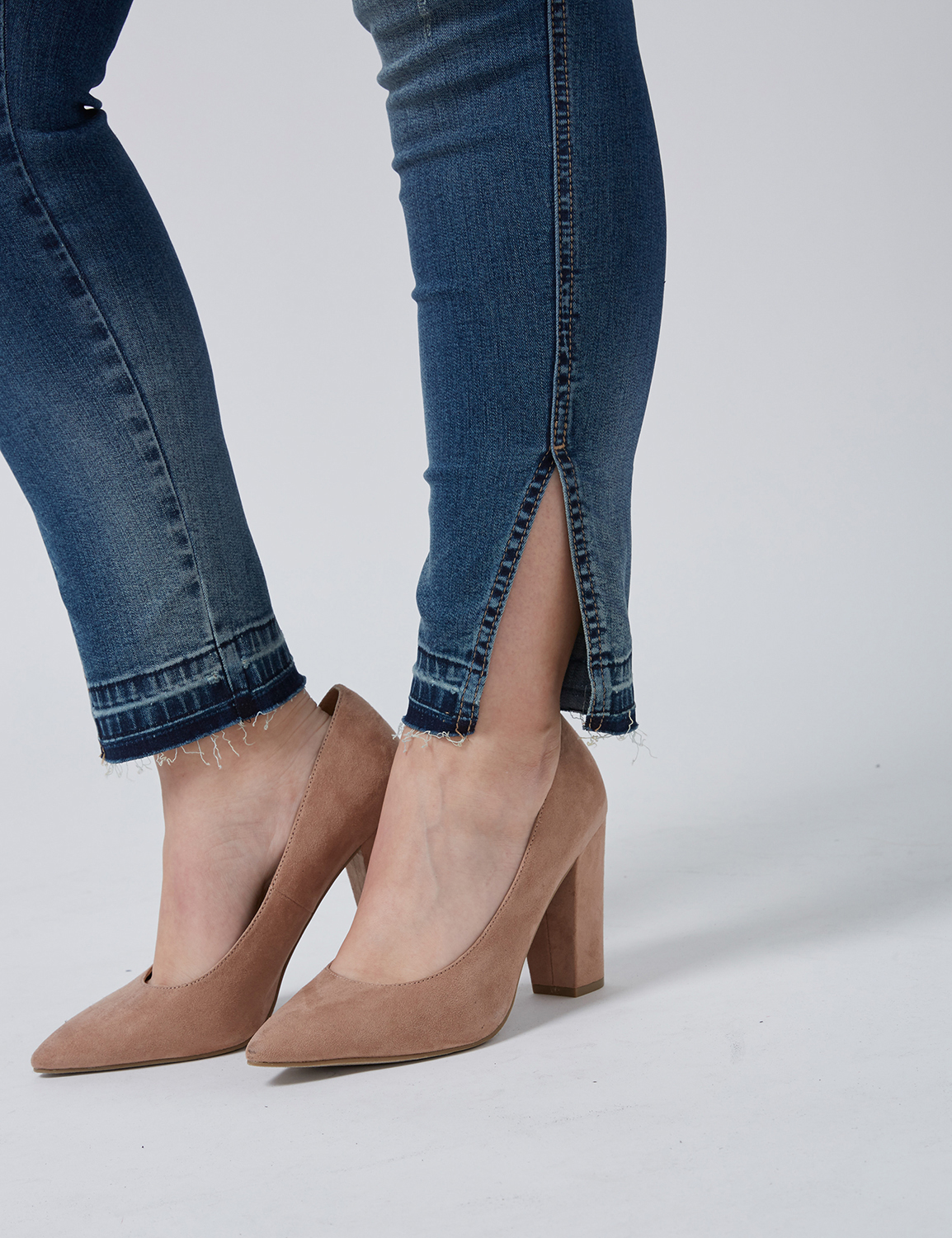 ankle shot of split cuff jeans with unfinished hem