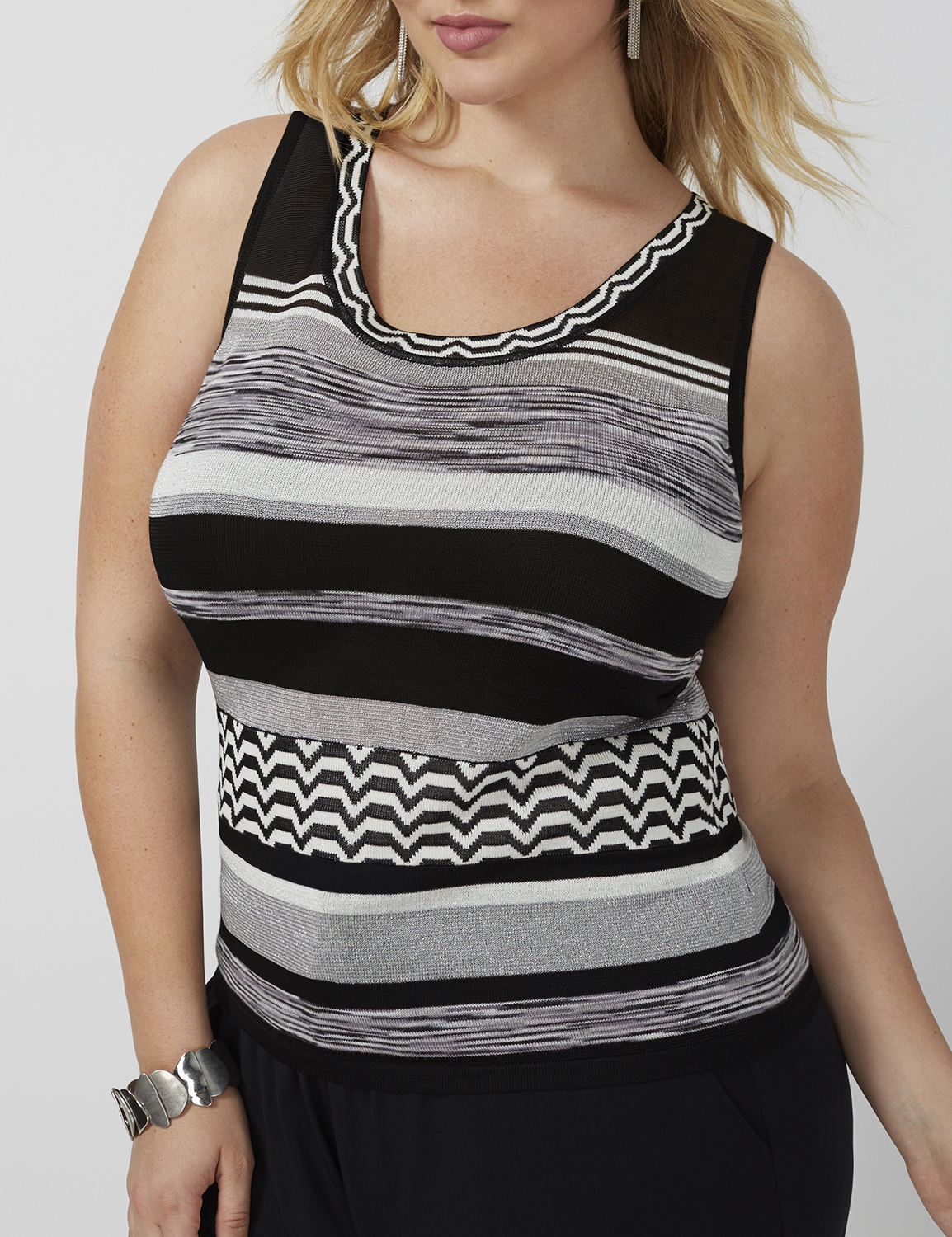 retouched blonde fashion model wearing black and gray striped tank top