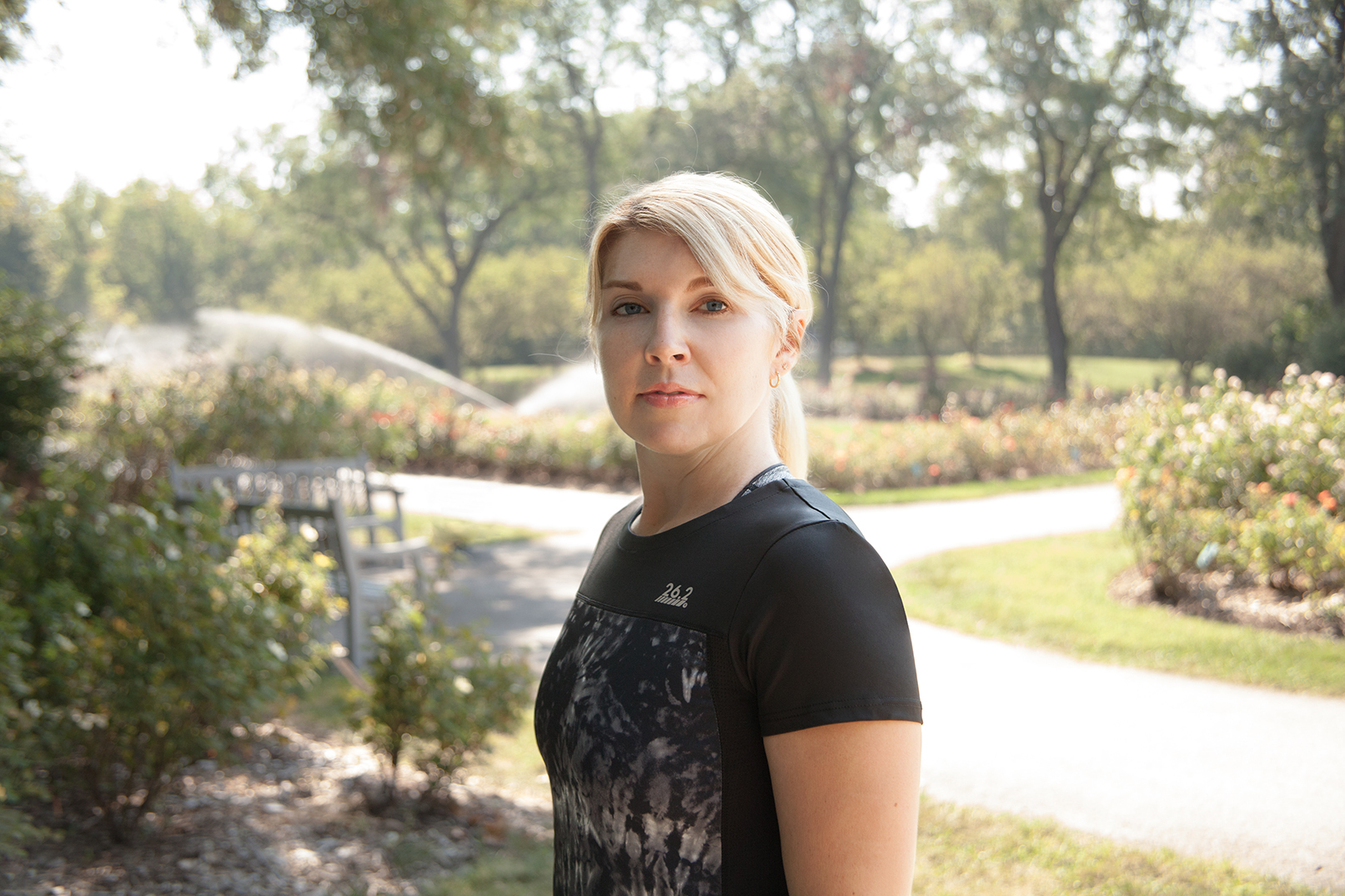 retouched woman wearing athletic gear in Whetstone Park of Roses