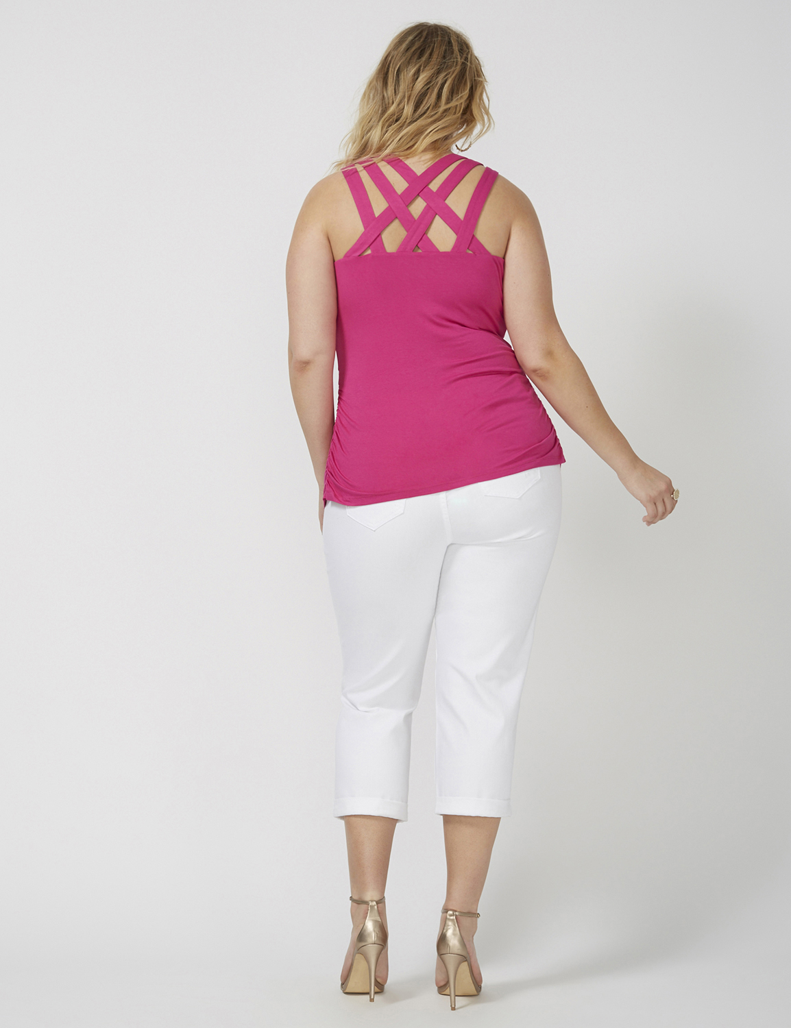 retouched back of fashion model wearing pink tank top and white capris for ecommerce site
