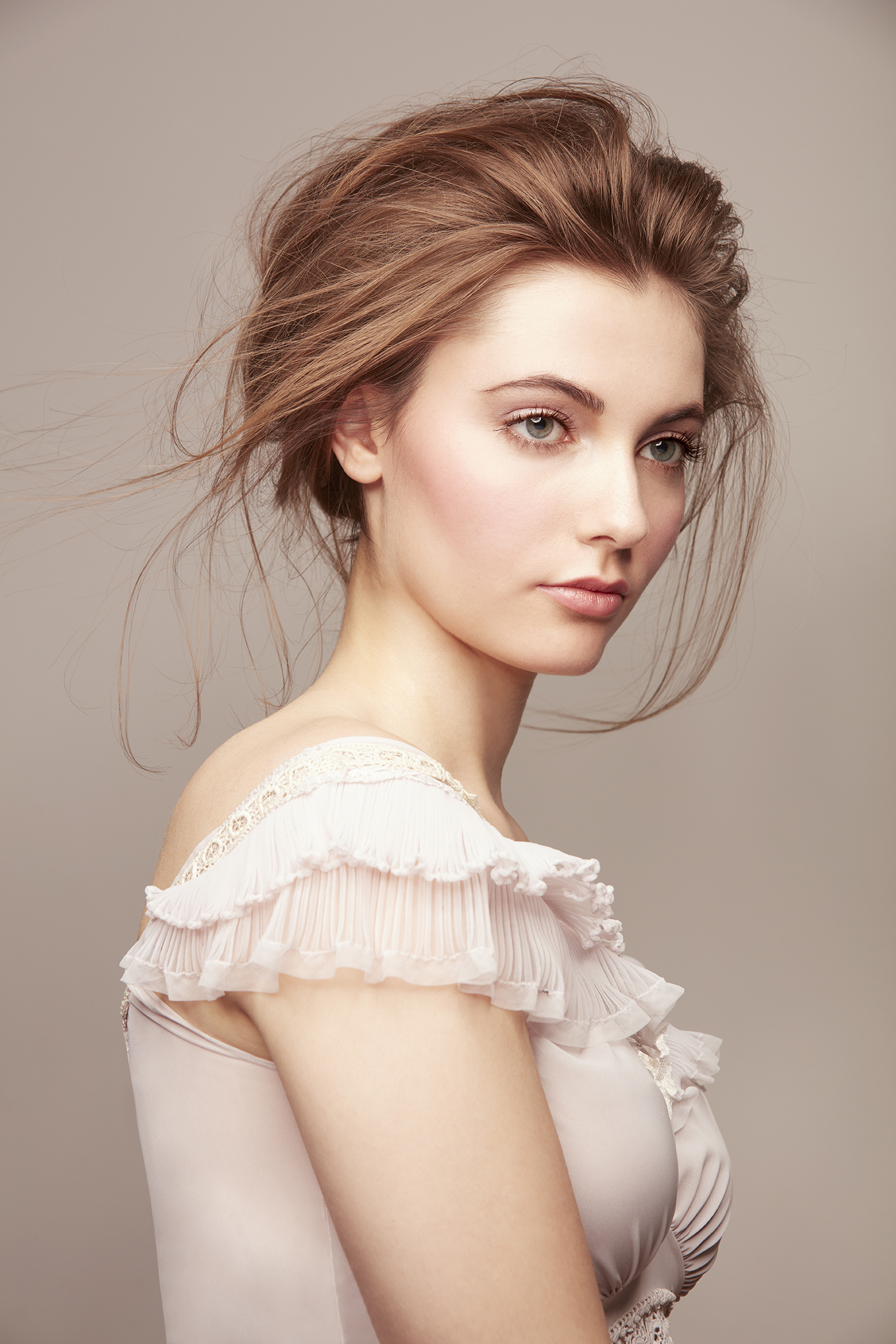 retouched woman in lacy dress with loose, romantic up-do