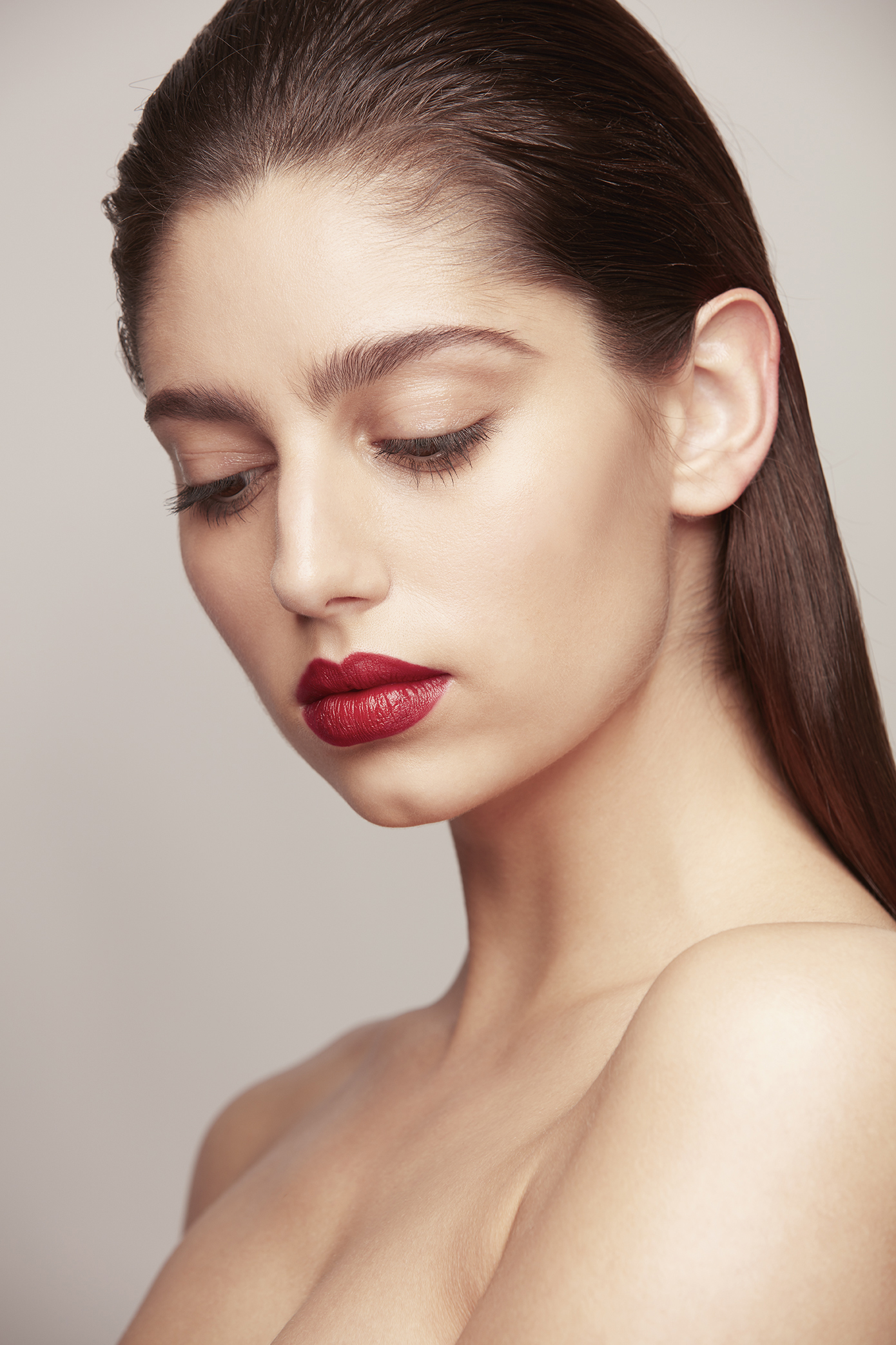 retouched woman with swept back hair and red lipstick