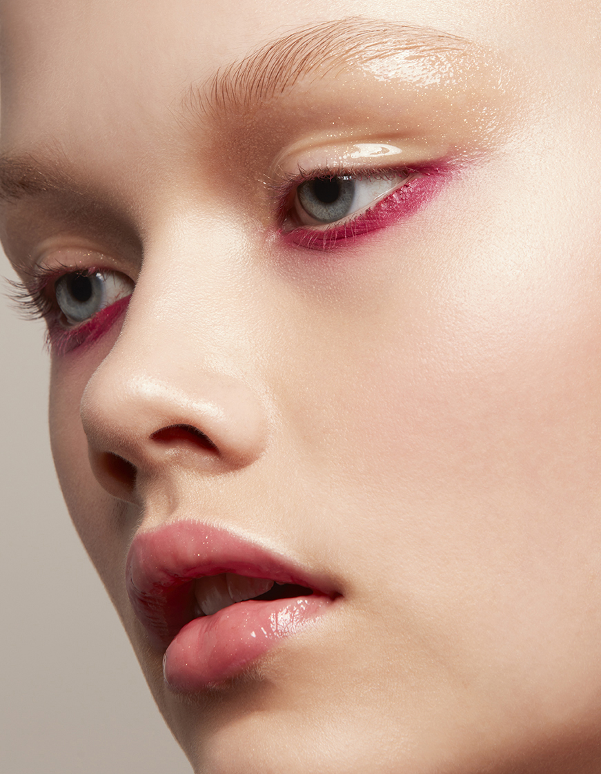 retouched closeup of woman wearing bright magenta eye makeup