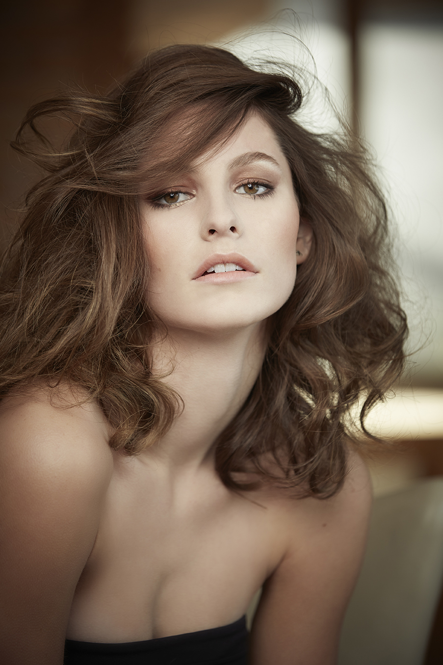 retouched model with loose wavy curls