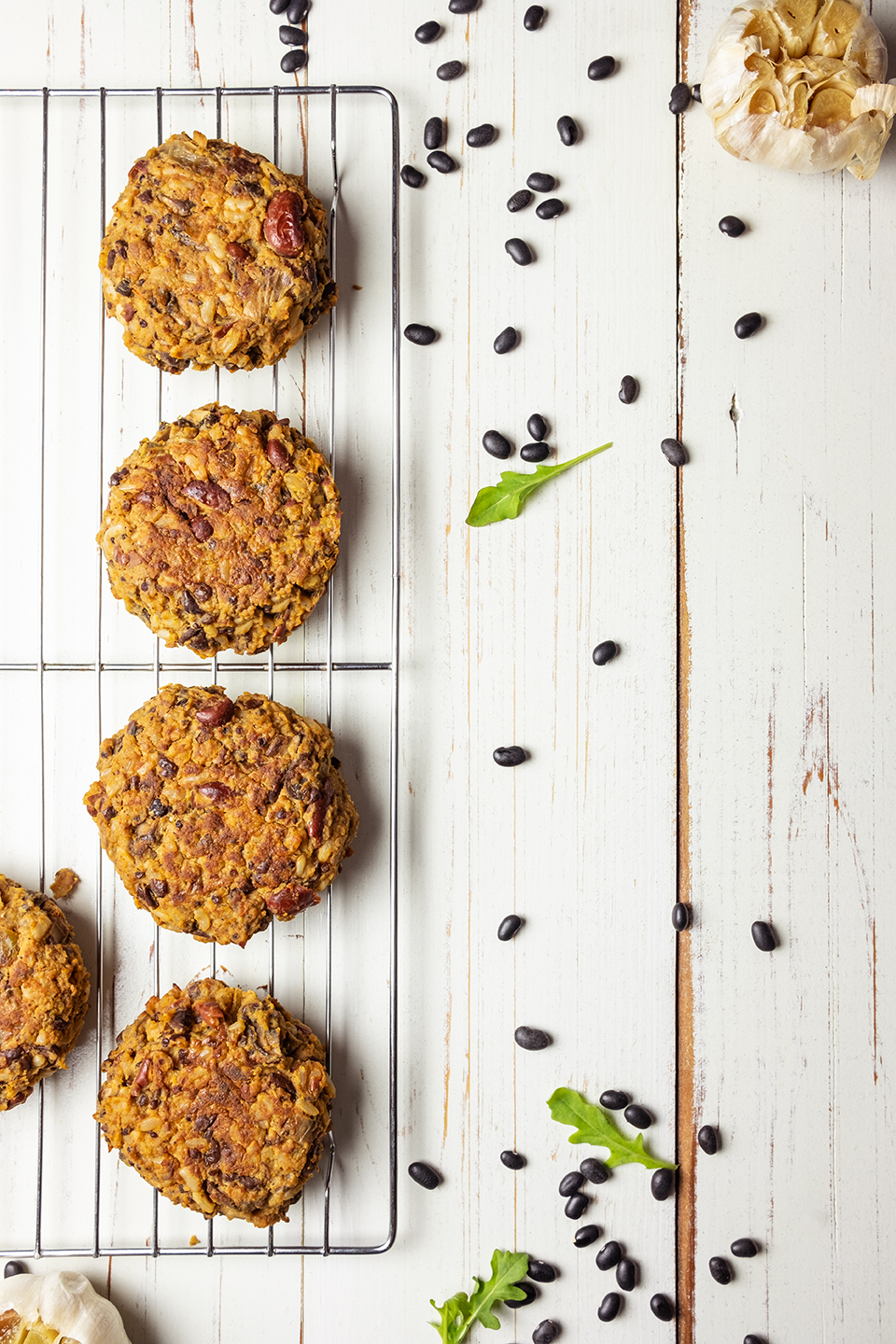 retouched black bean veggie patties resting on a metal cooling rack