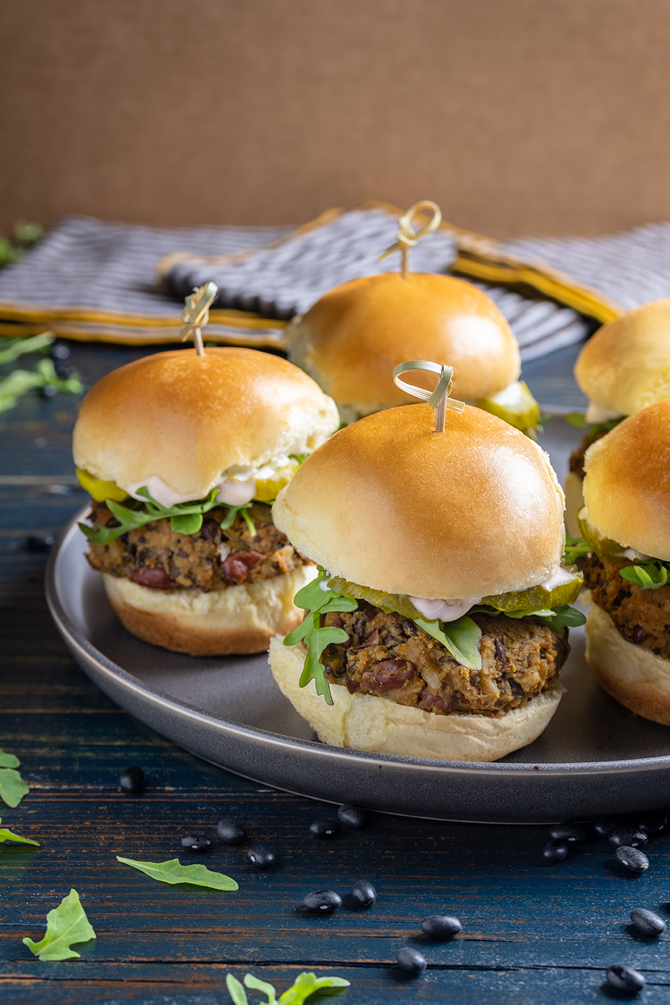 retouched plate of black bean sliders with arugula on mini buns