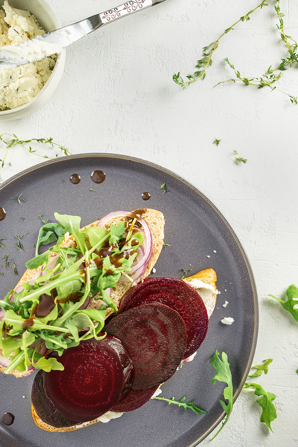 retouched roasted beet sandwich with arugula and goat cheese