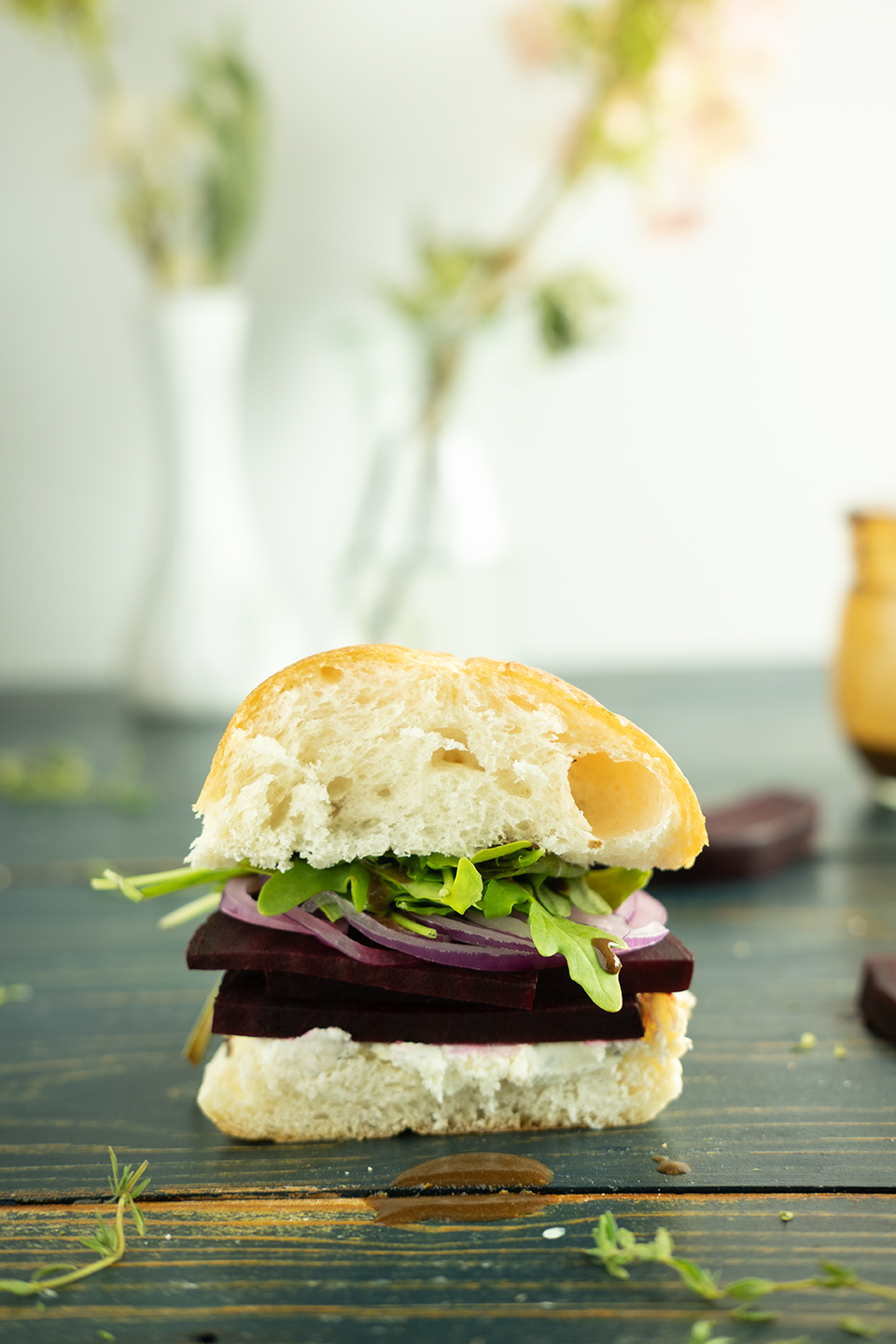 sliced roasted beet sandwich with arugula and goat cheese
