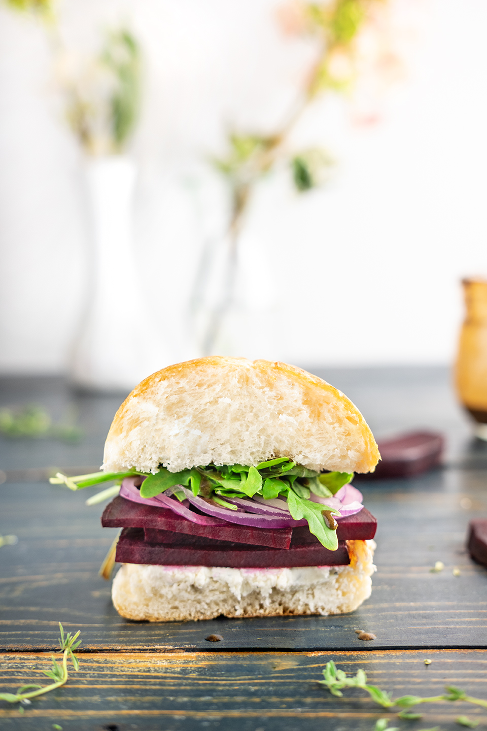 retouched sliced roasted beet sandwich with arugula and goat cheese