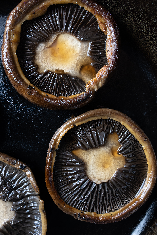 sauteed portabella mushroom cap in iron skillet
