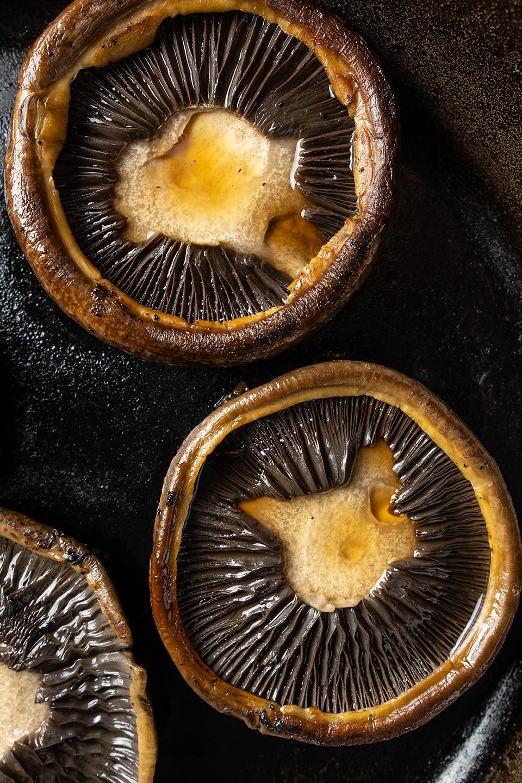 retouched sauteed portabella mushroom cap in iron skillet