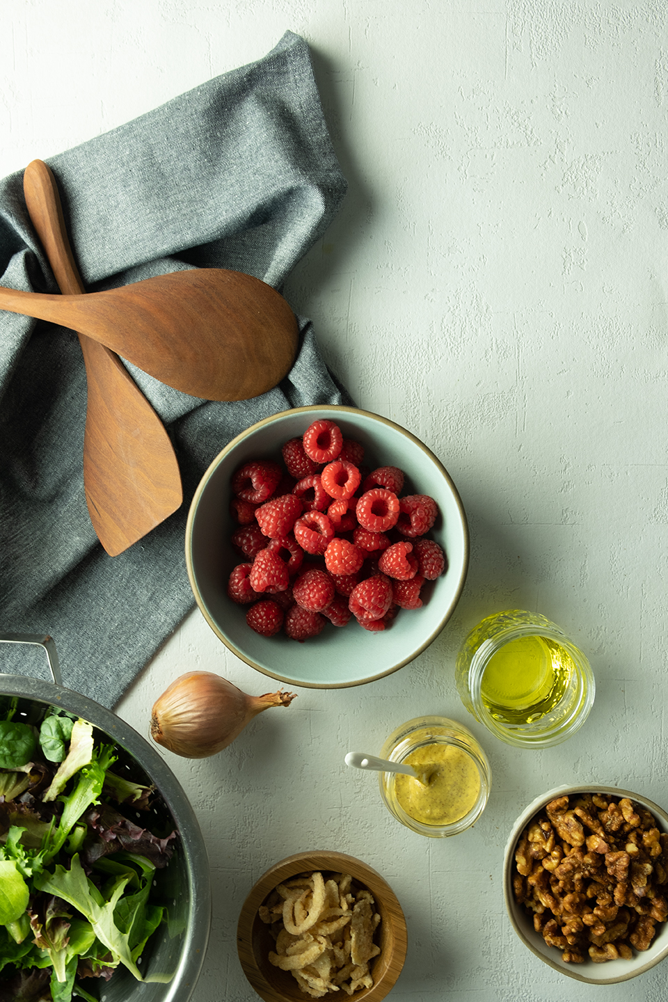 ingredients for fresh summer salad with raspberries and walnuts