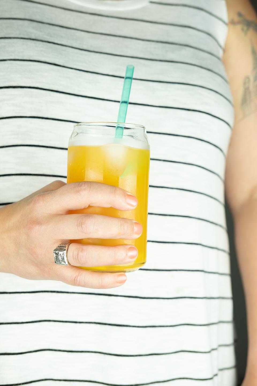 JodiLoves-Mango-Basil-Fizzy-Mocktail-Hands-BEFORE.jpg