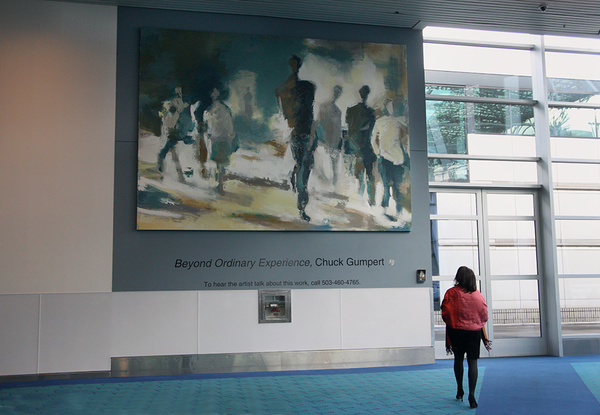 "This bigger-than- life painting is on display in the North ticket lobby. ""Beyond Ordinary Experience' is an installation designed specifically for this large wall space by artist Chuck Gumpert. ""My quest is to portray a sort of transcendent character in a setting that could be anywhere in the world,"" Gumpert reflects."