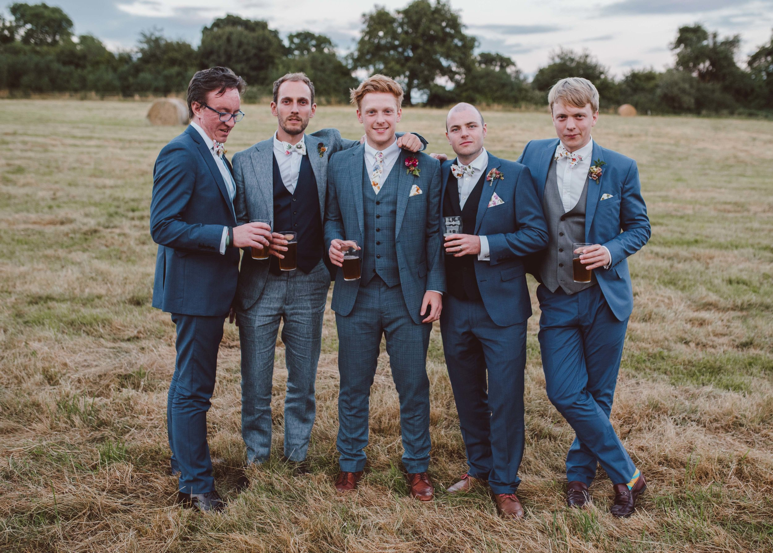 Summer wedding groomsmen mismatched style