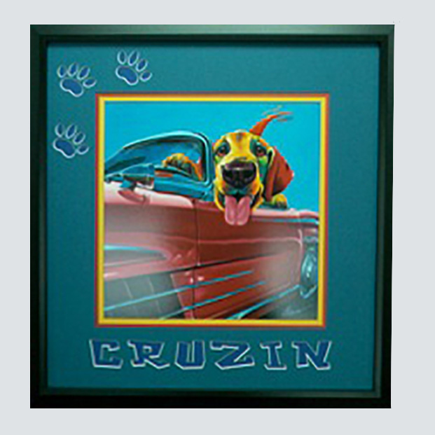 Computerized mat with cutouts of paws and 'Crusin'-poster of dog riding in a convertible.