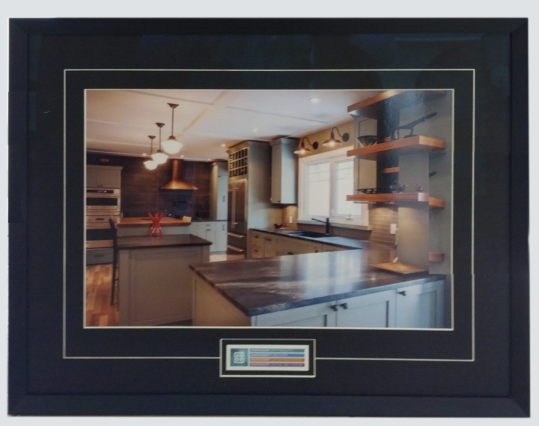 Framed and matted photograph of kitchen for custom renovations company's office