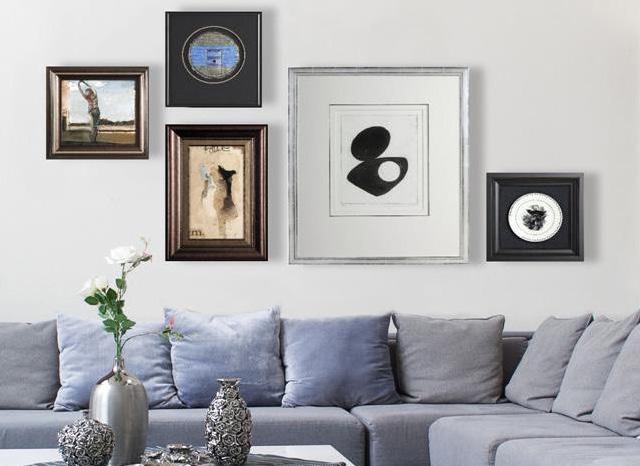 an arrangement of wall art in living room