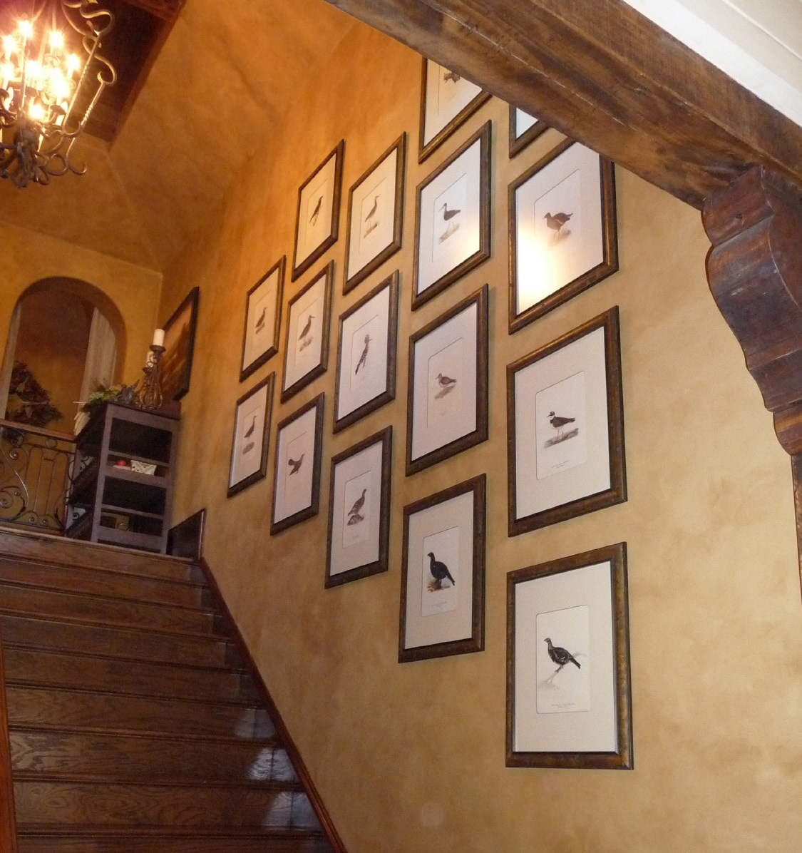 photographs arranged on a staircase wall