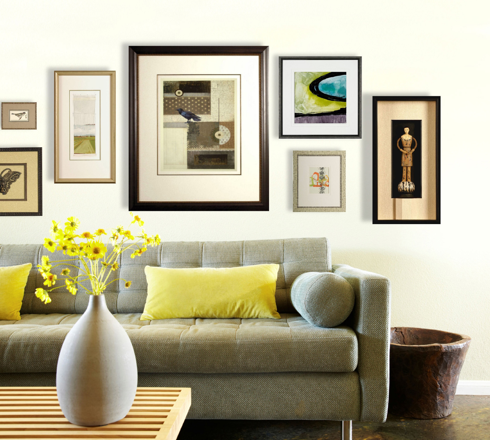 A variety of art hanging on living room wall